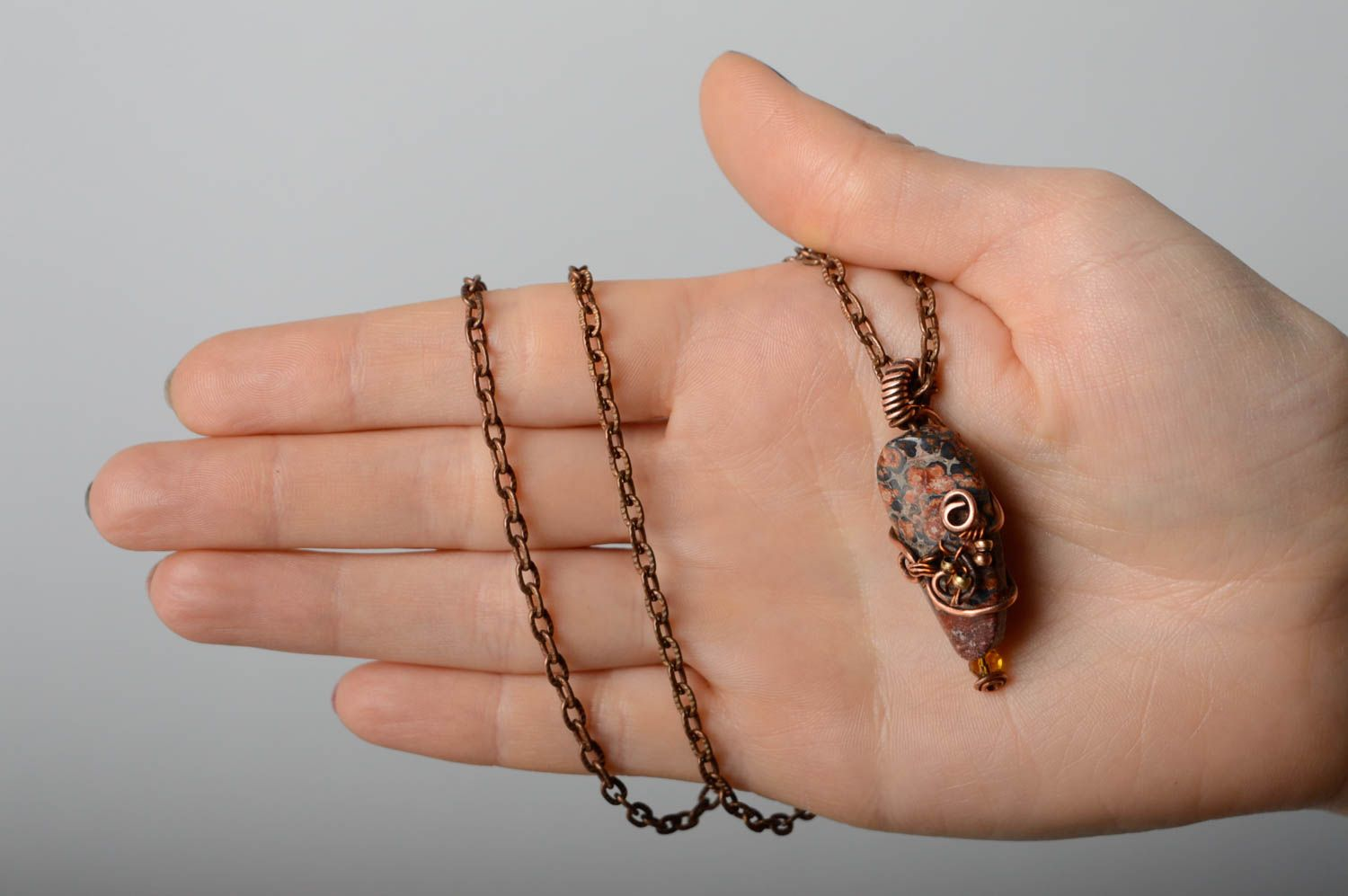 Metal pendant with natural stone photo 4