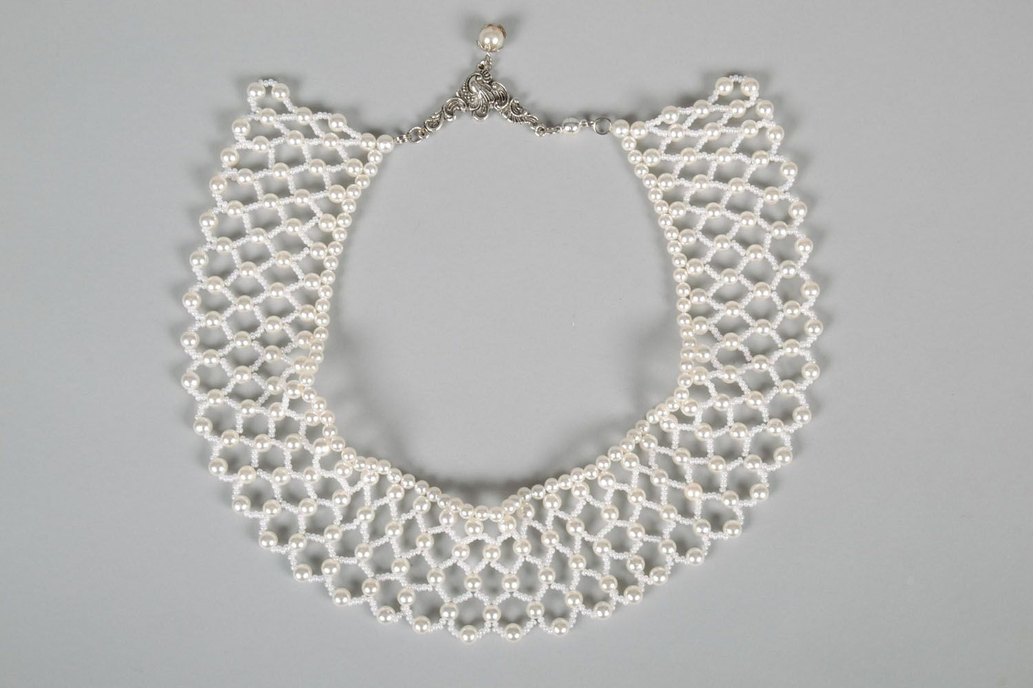 Lacy necklace made of white beads photo 5