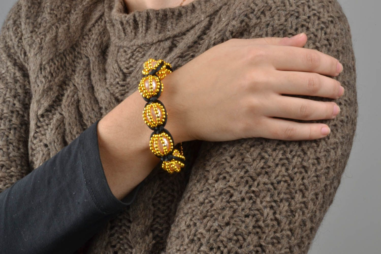 Yellow braided bracelet  photo 1