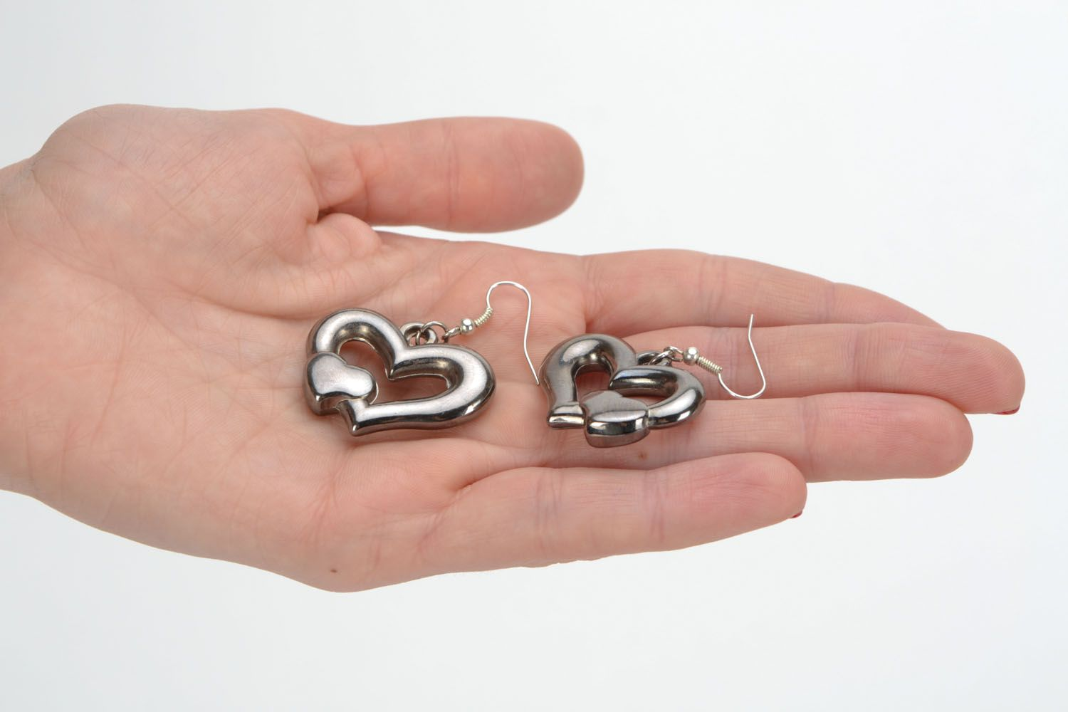Metal earrings with heart-shaped charms photo 2