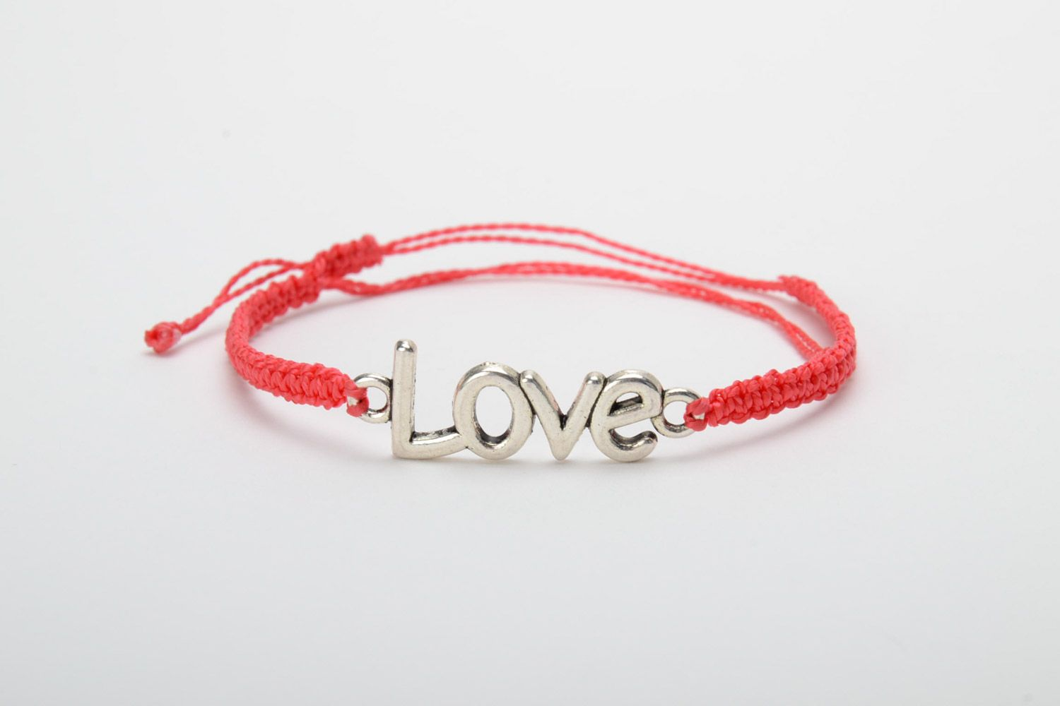 Handmade women's woven cord bracelet of red color with metal charm lettering photo 5
