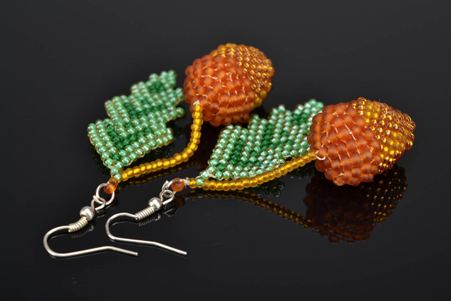 Beaded earrings with acorn charms photo 1