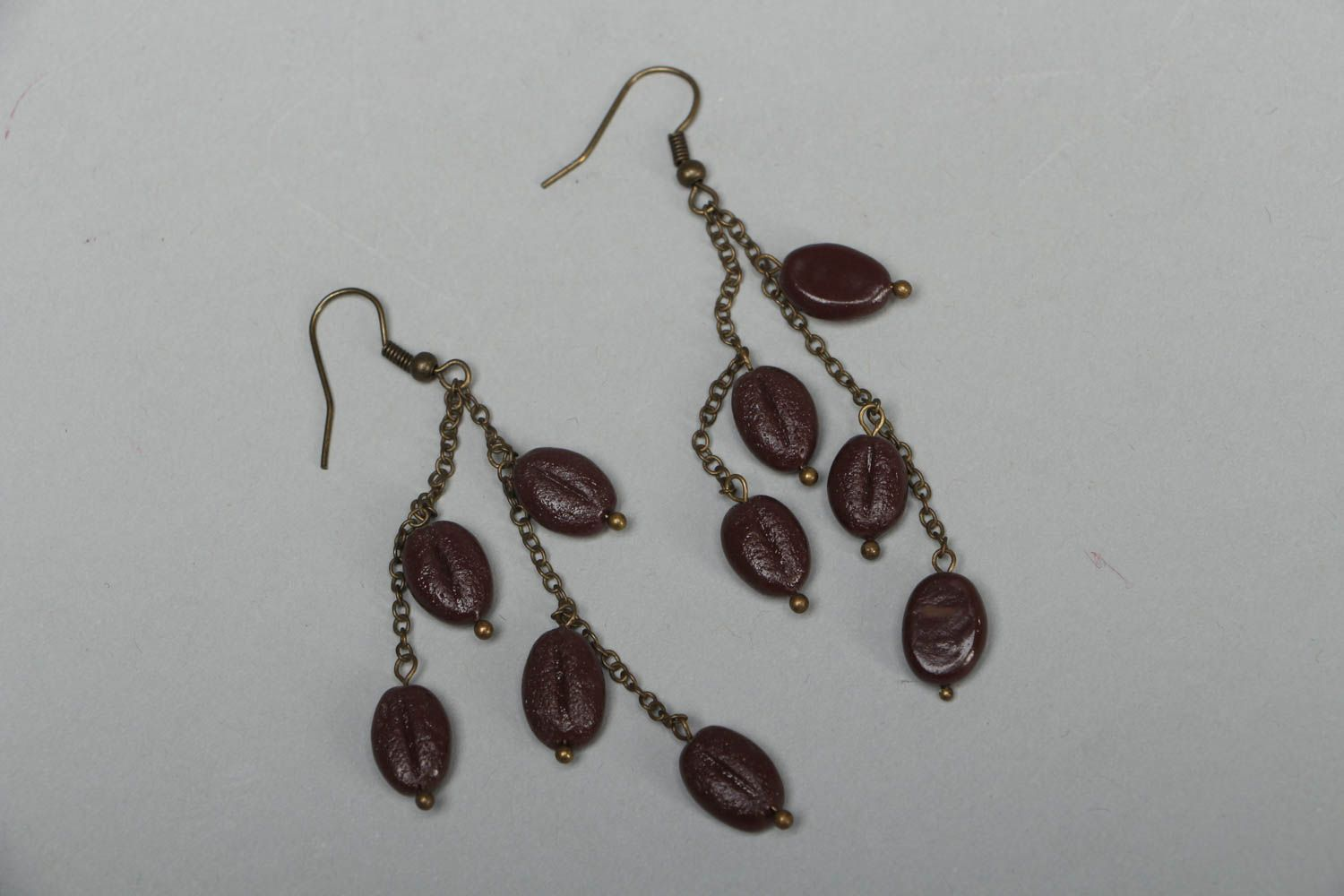 Unusual earrings with plastic charms photo 1