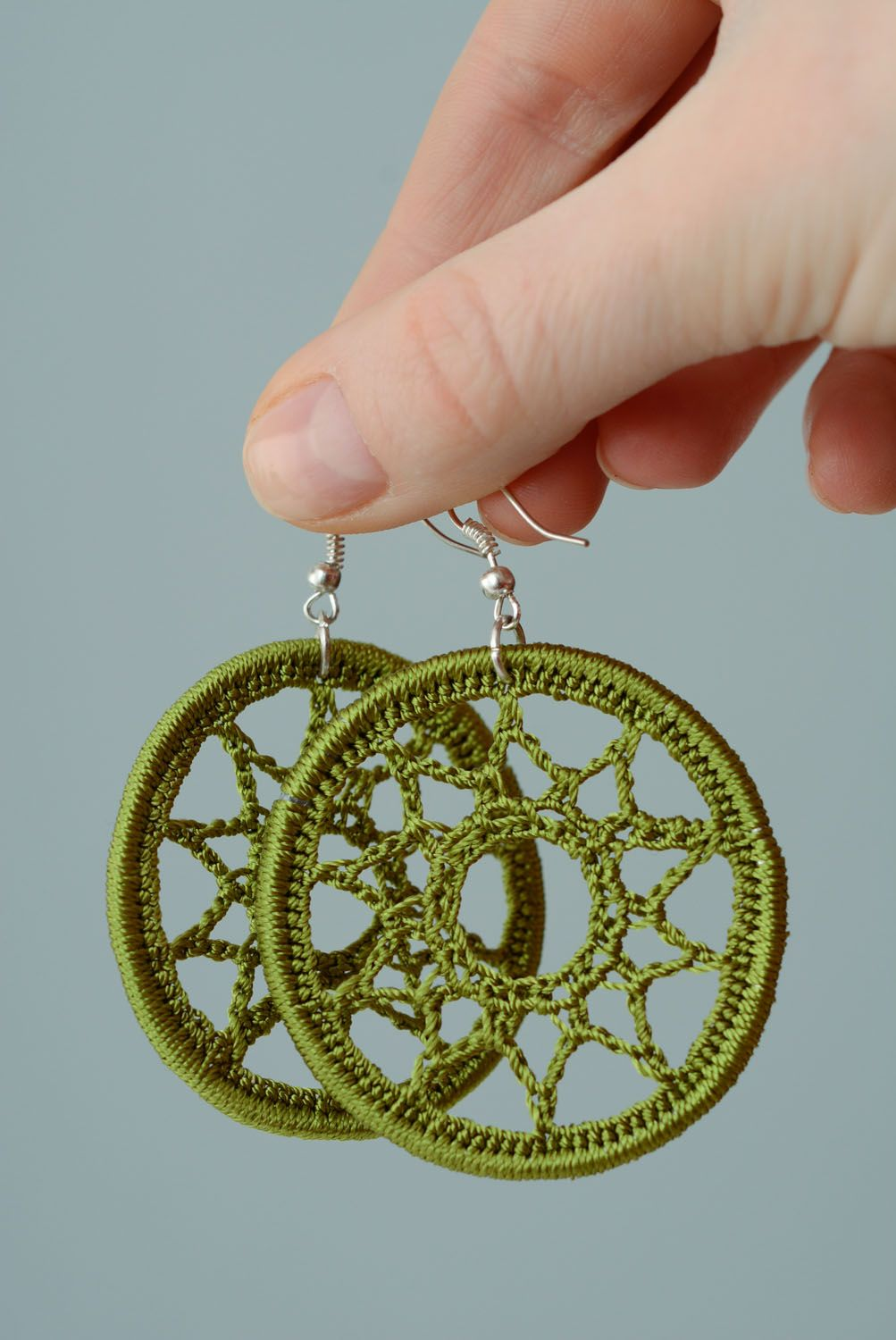 Earrings woven of green threads photo 3