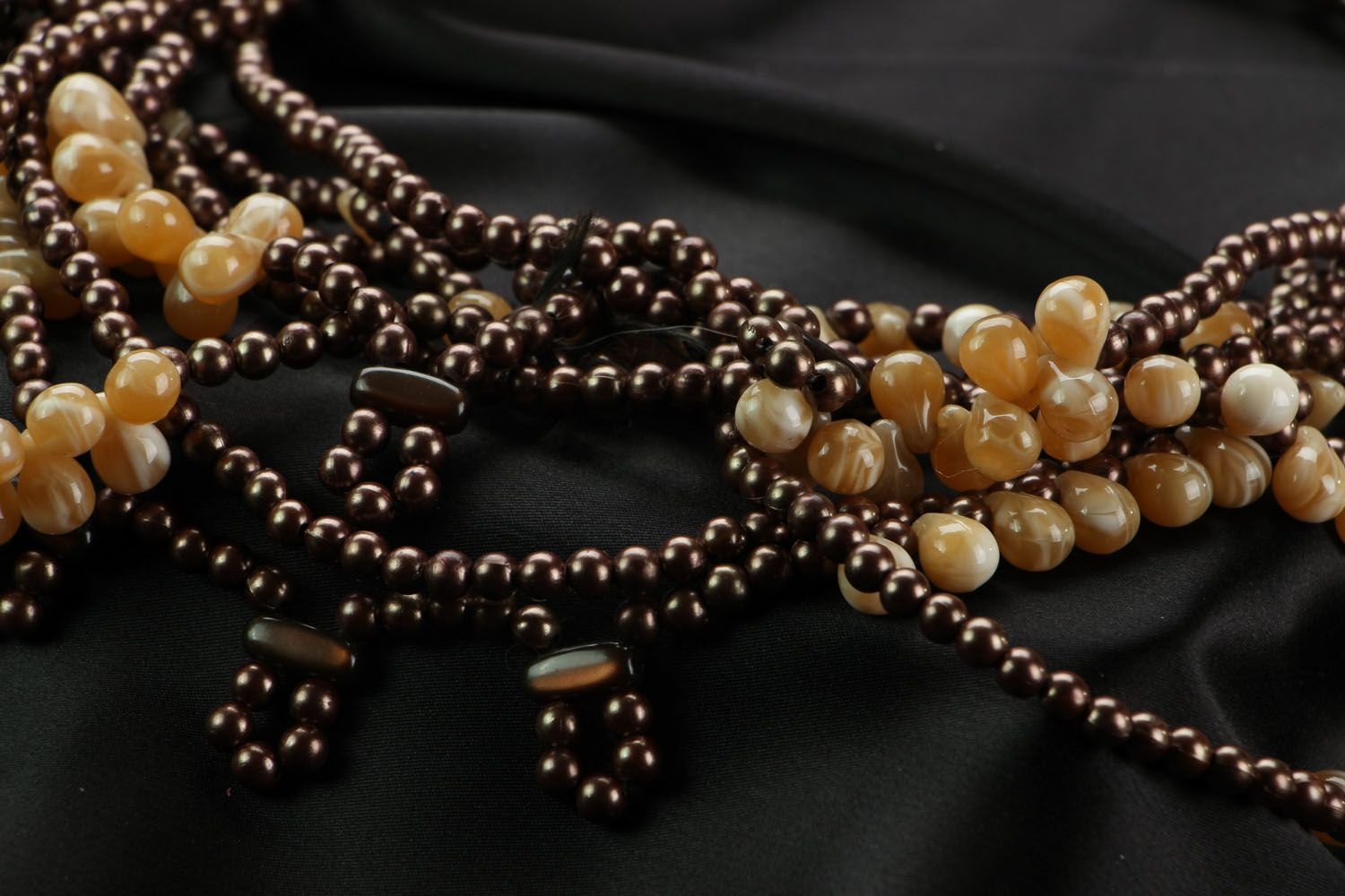 Ethnic beaded necklace in brown and beige colors photo 3