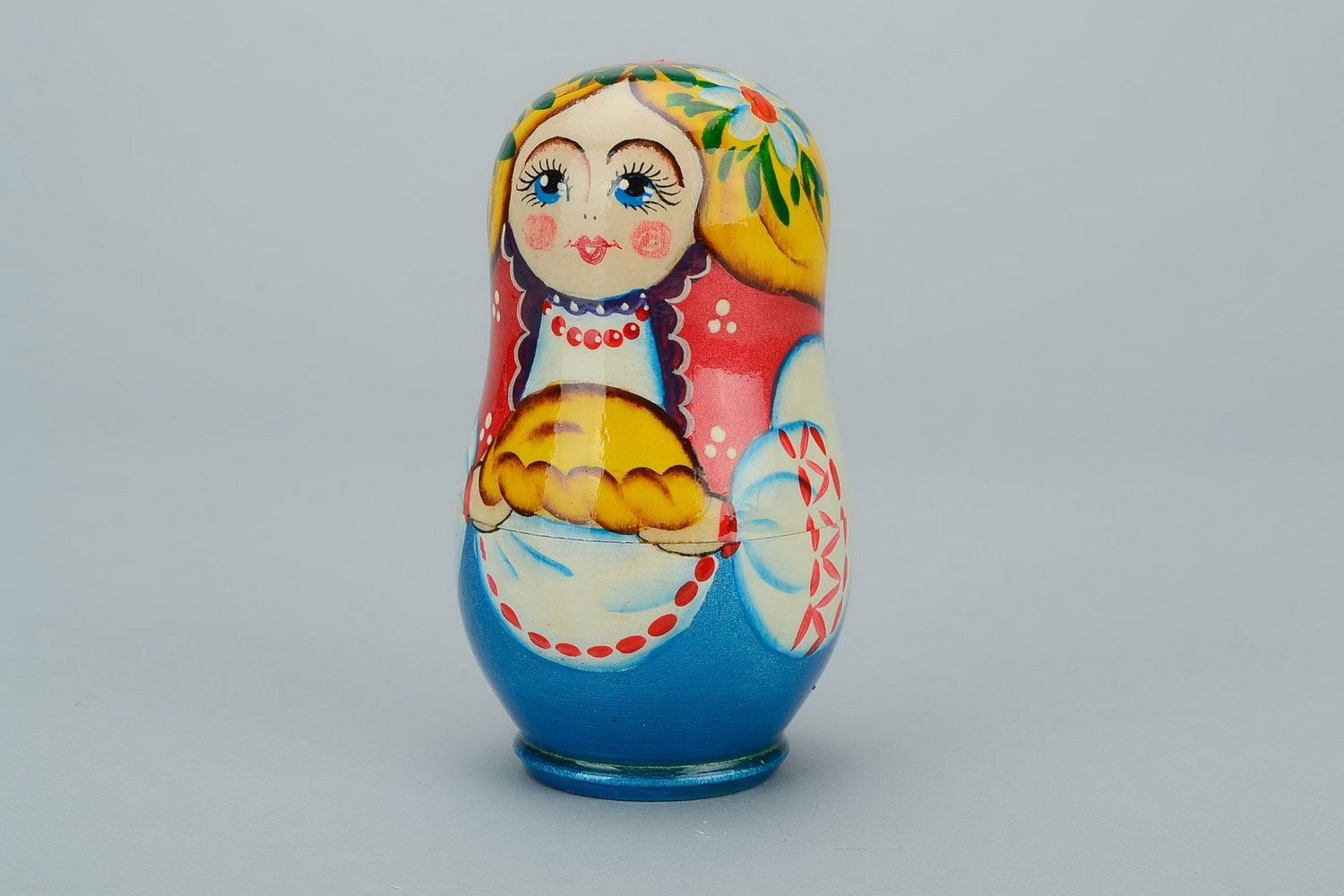 Wooden matryoshka doll with loaf photo 2