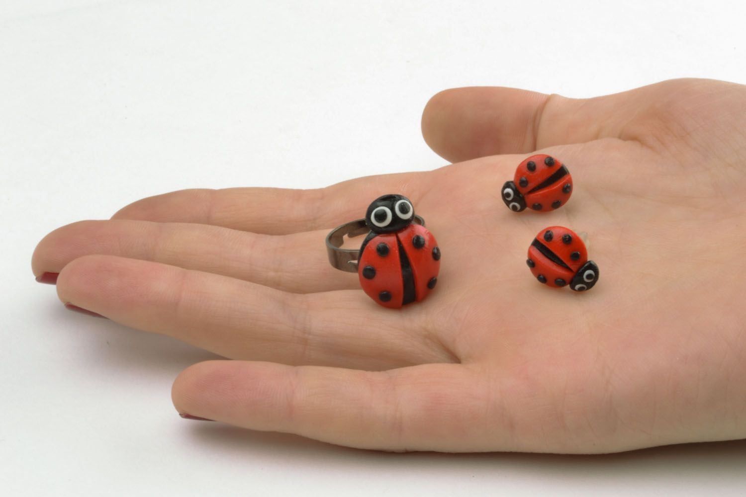 Plastic ring and earrings in the shape of ladybugs photo 2