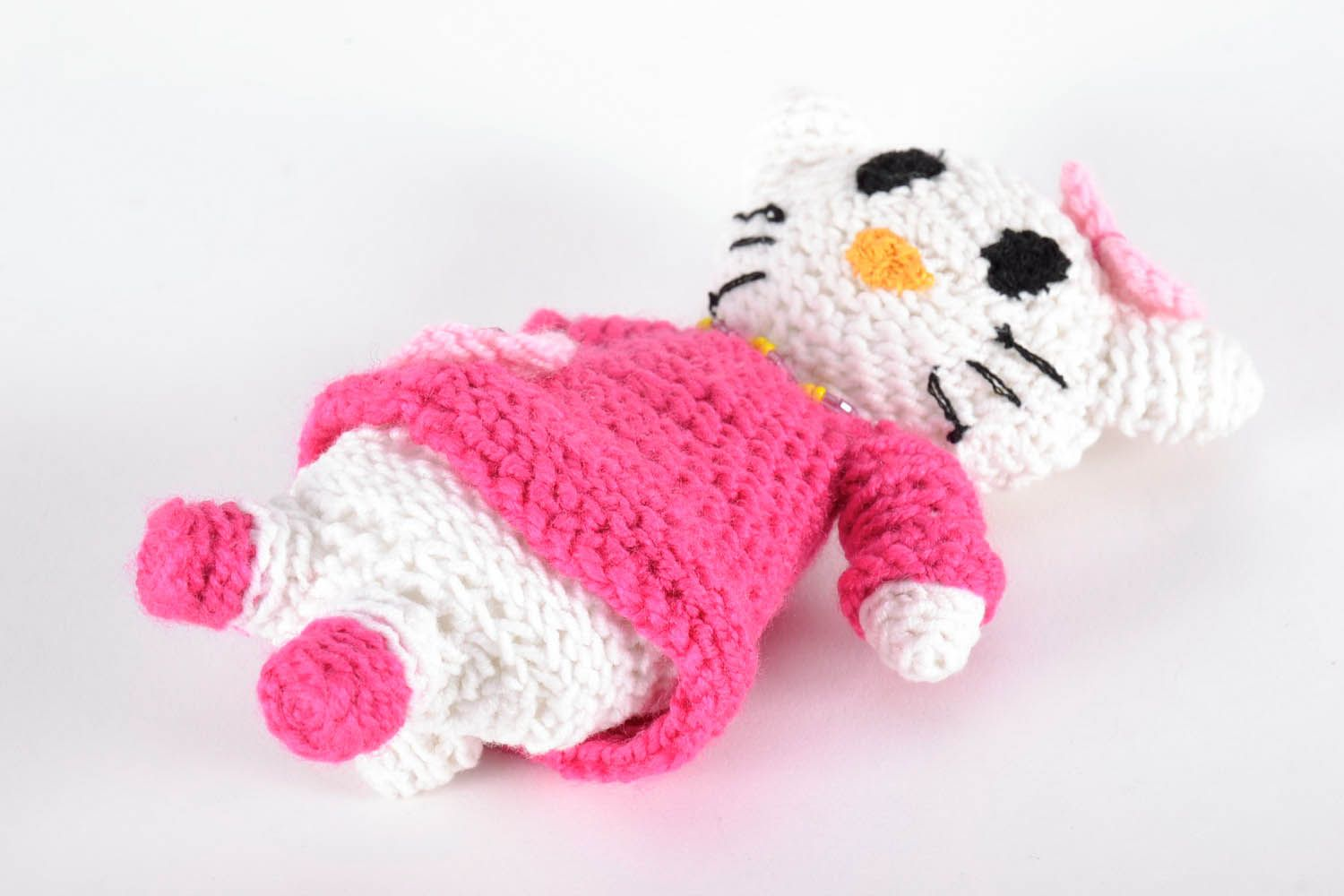 Toy crocheted around with wool threads photo 2