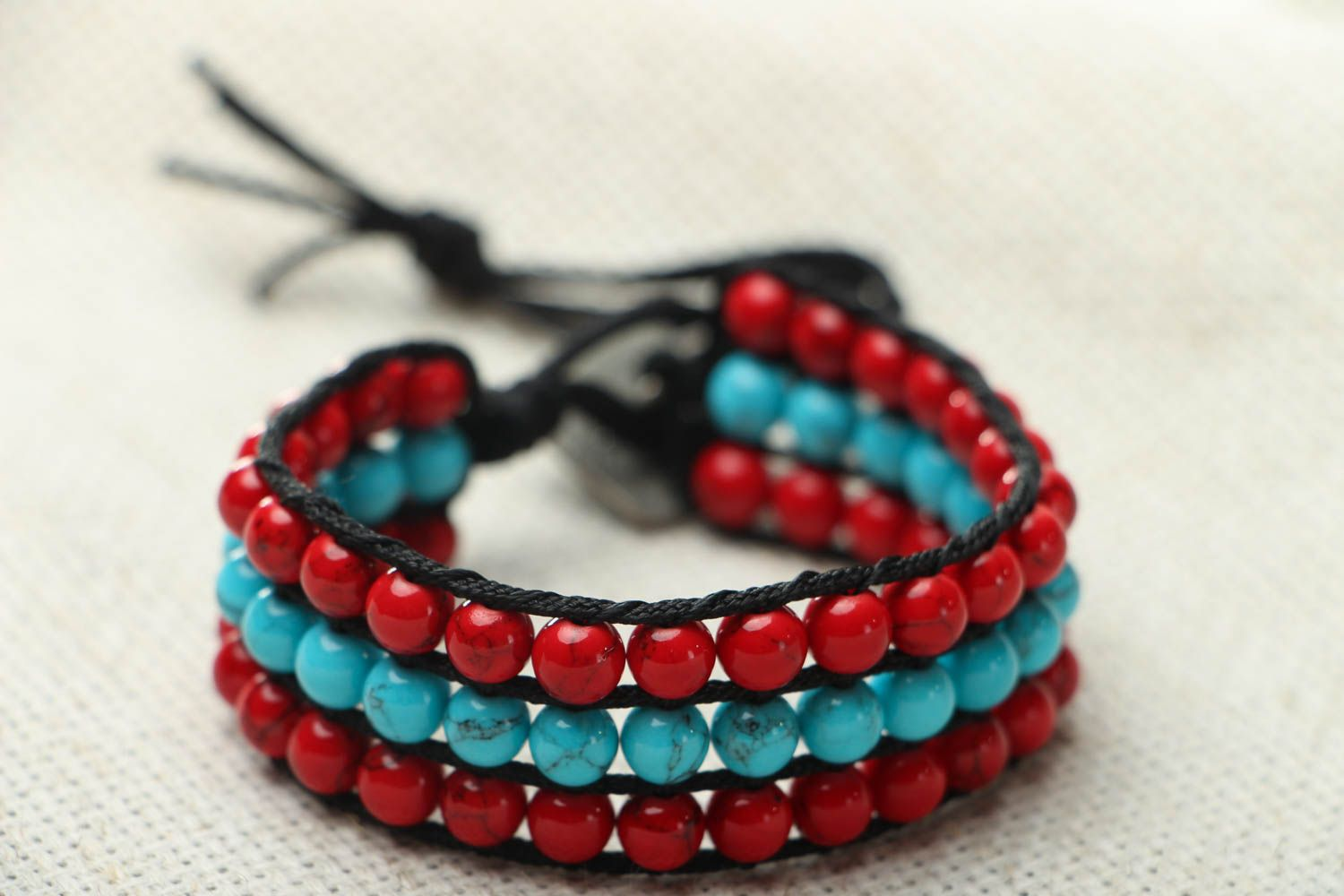 Woven bracelet with coral and turquoise photo 2