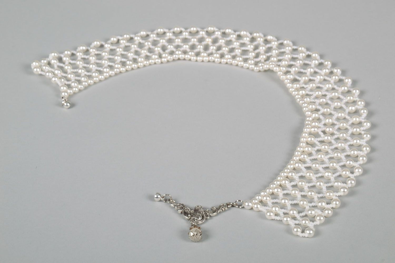 Lacy necklace made of white beads photo 3