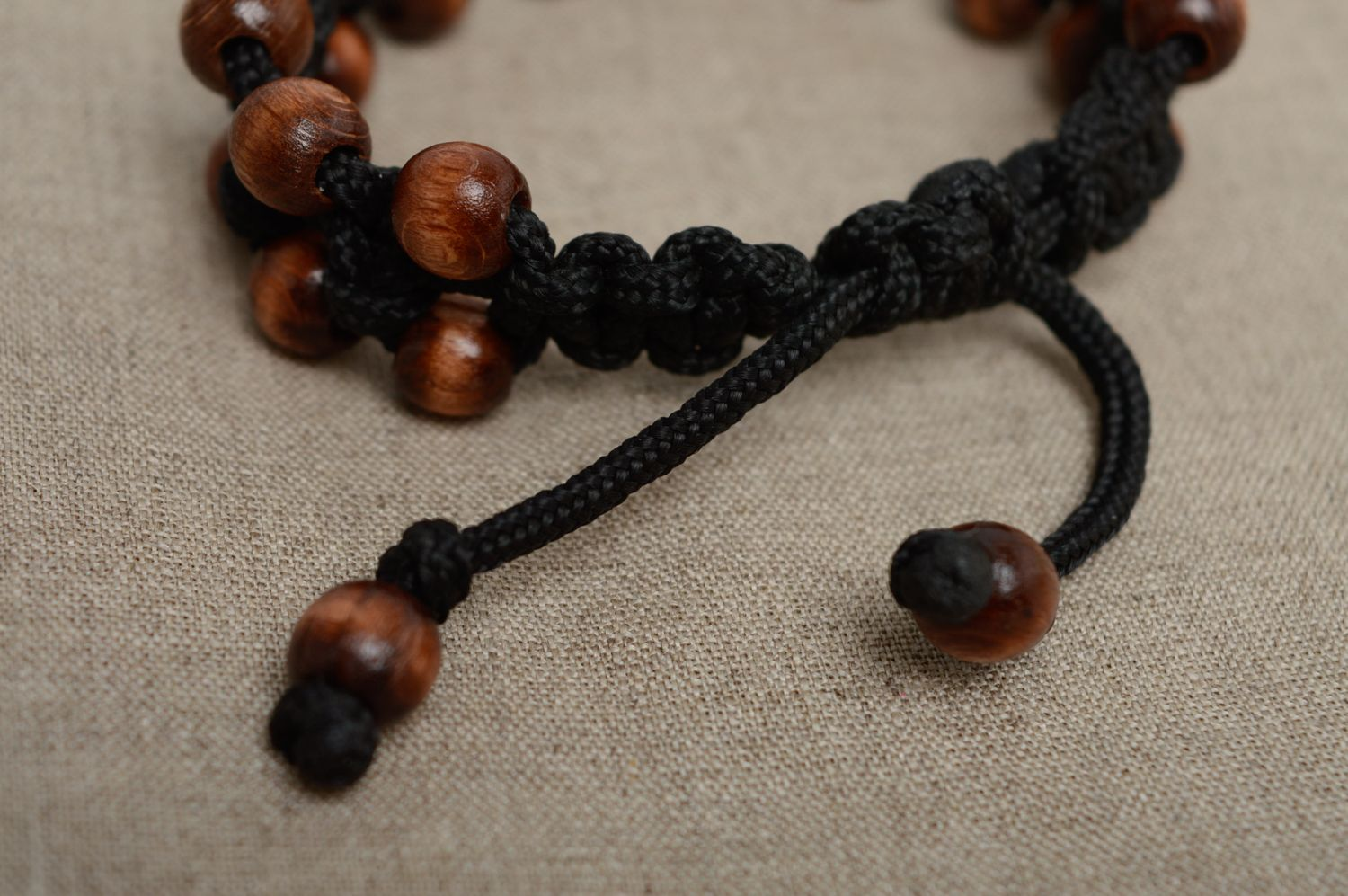 Macrame woven cord bracelet with wooden beads photo 4