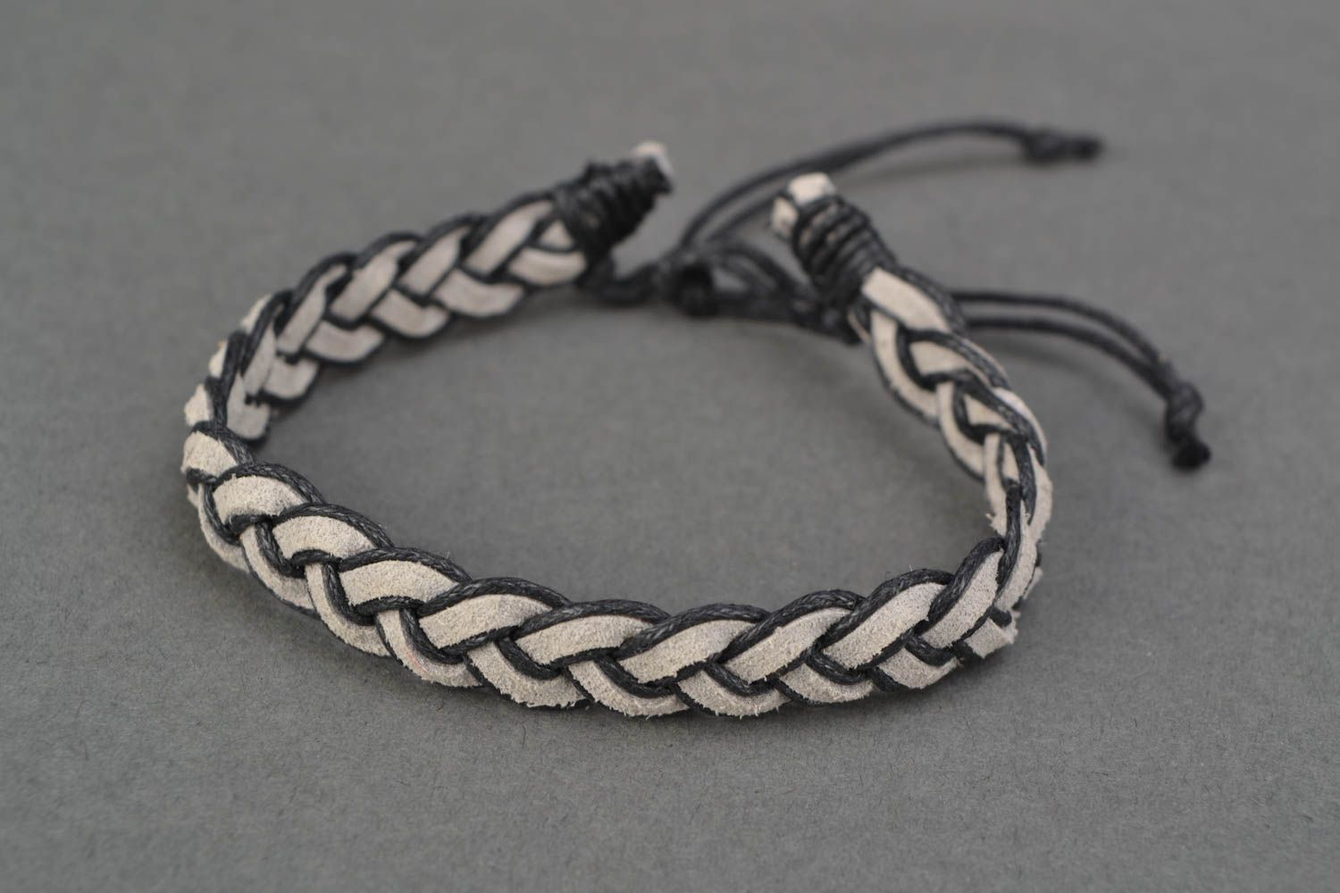 Woven suede bracelet with ties photo 3