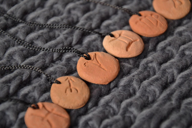 Ceramic pendant with zodiac sign photo 1