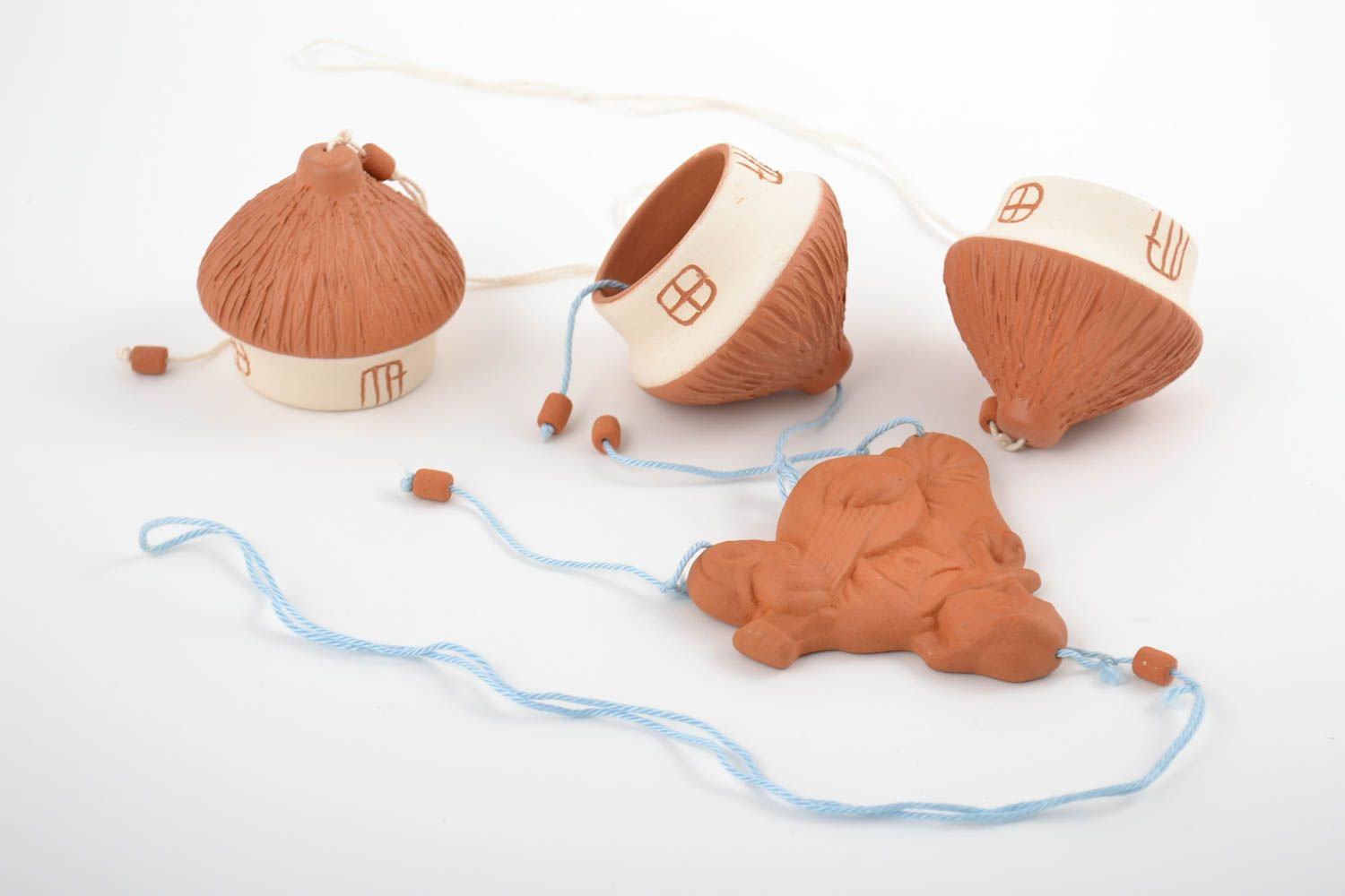 Handmade designer ceramic bells in the shape of houses painted with engobes photo 5