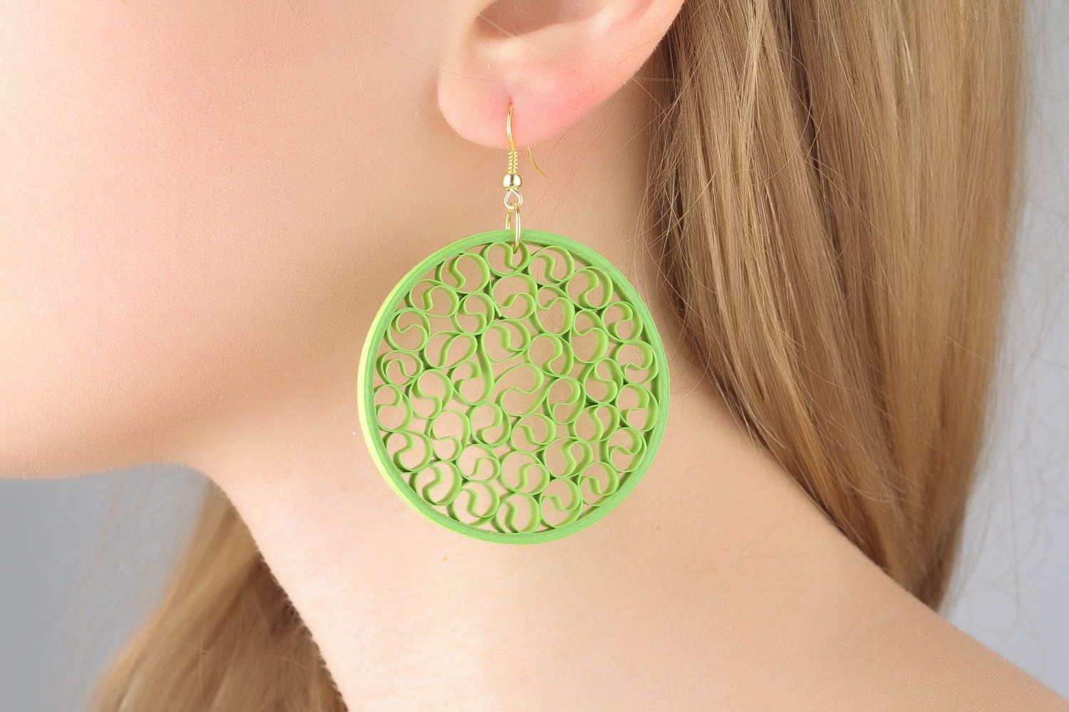 Openwork earrings made using quilling techniques photo 1