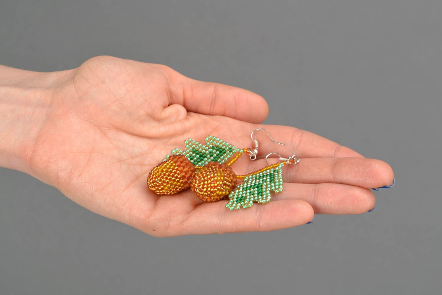 Beaded earrings with acorn charms photo 2