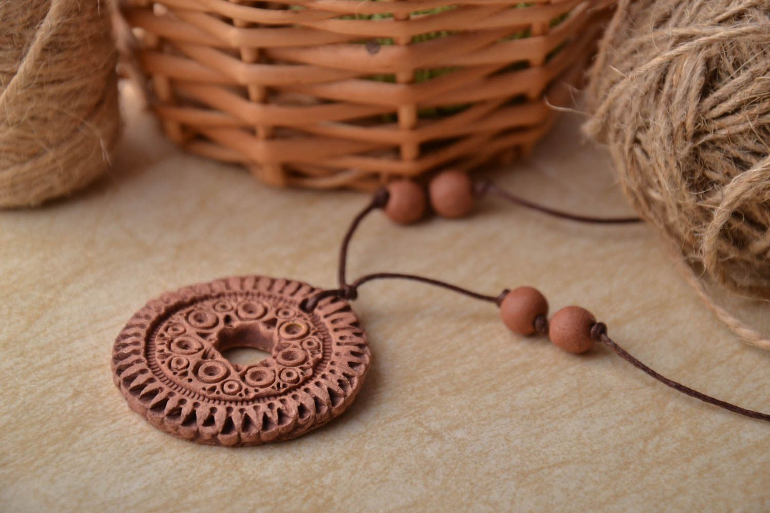 Brown clay pendant photo 1
