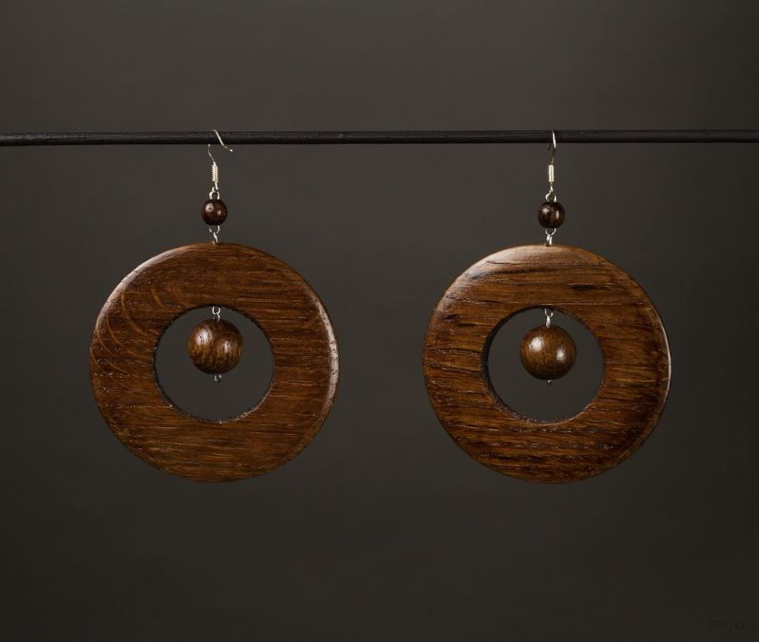 Round earrings made of wood photo 1