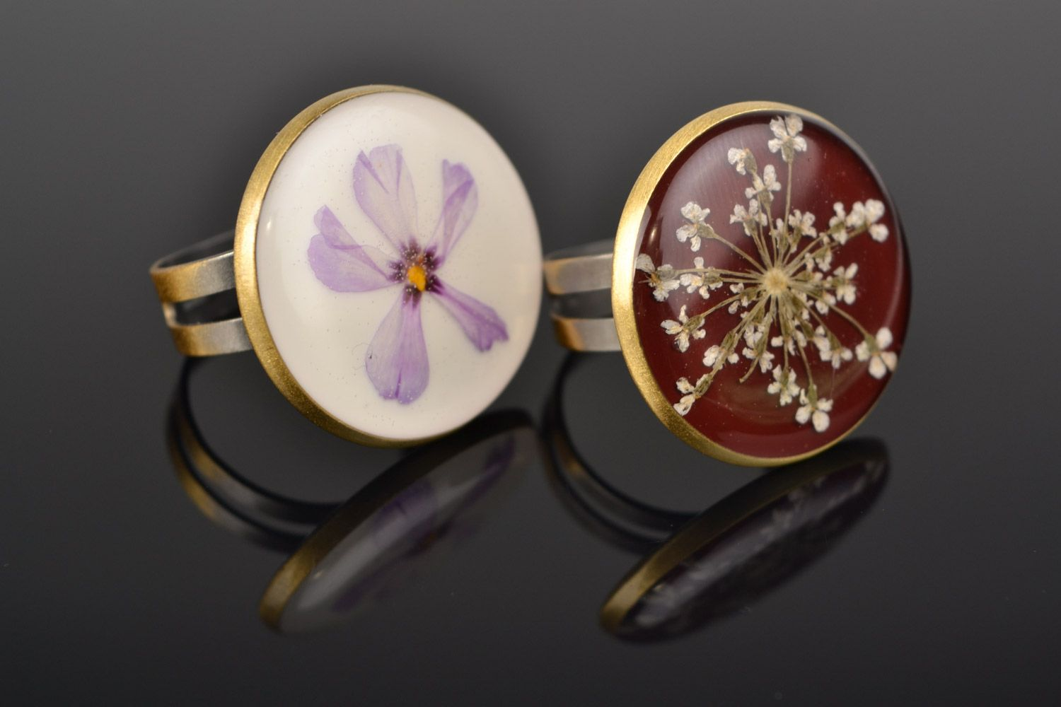 Two handmade flat round rings with natural flowers in epoxy resin for women photo 1