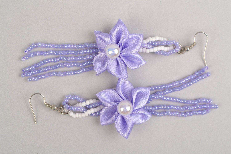 Braided handmade long purple earrings made of satin with flower photo 2
