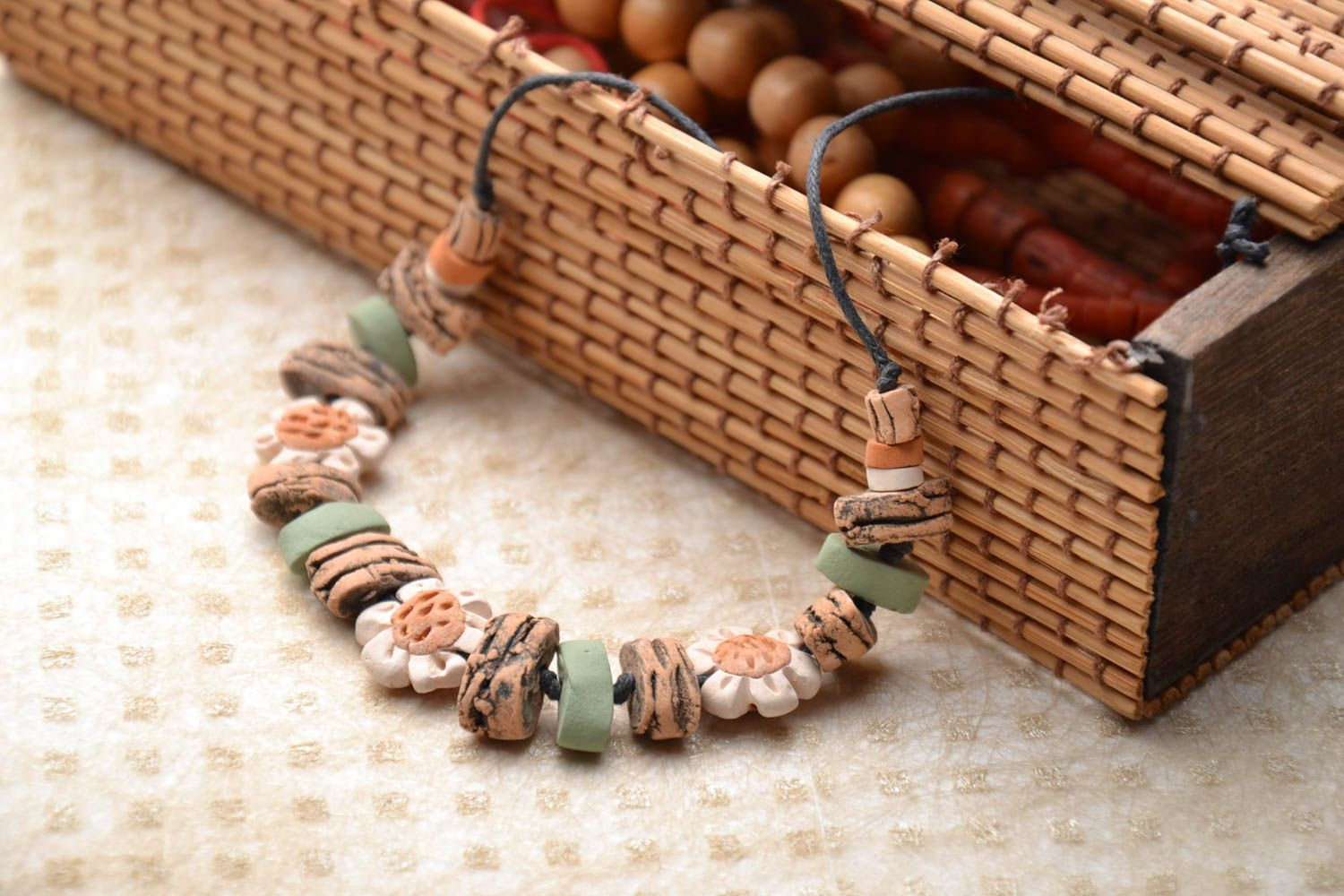 Ceramic bracelet with waxed cord  photo 1