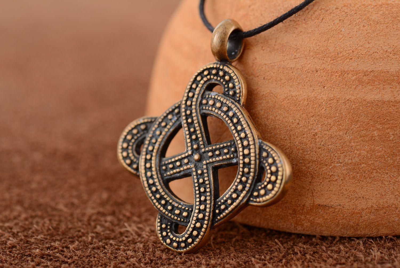 Bronze pendant with solar symbol photo 1