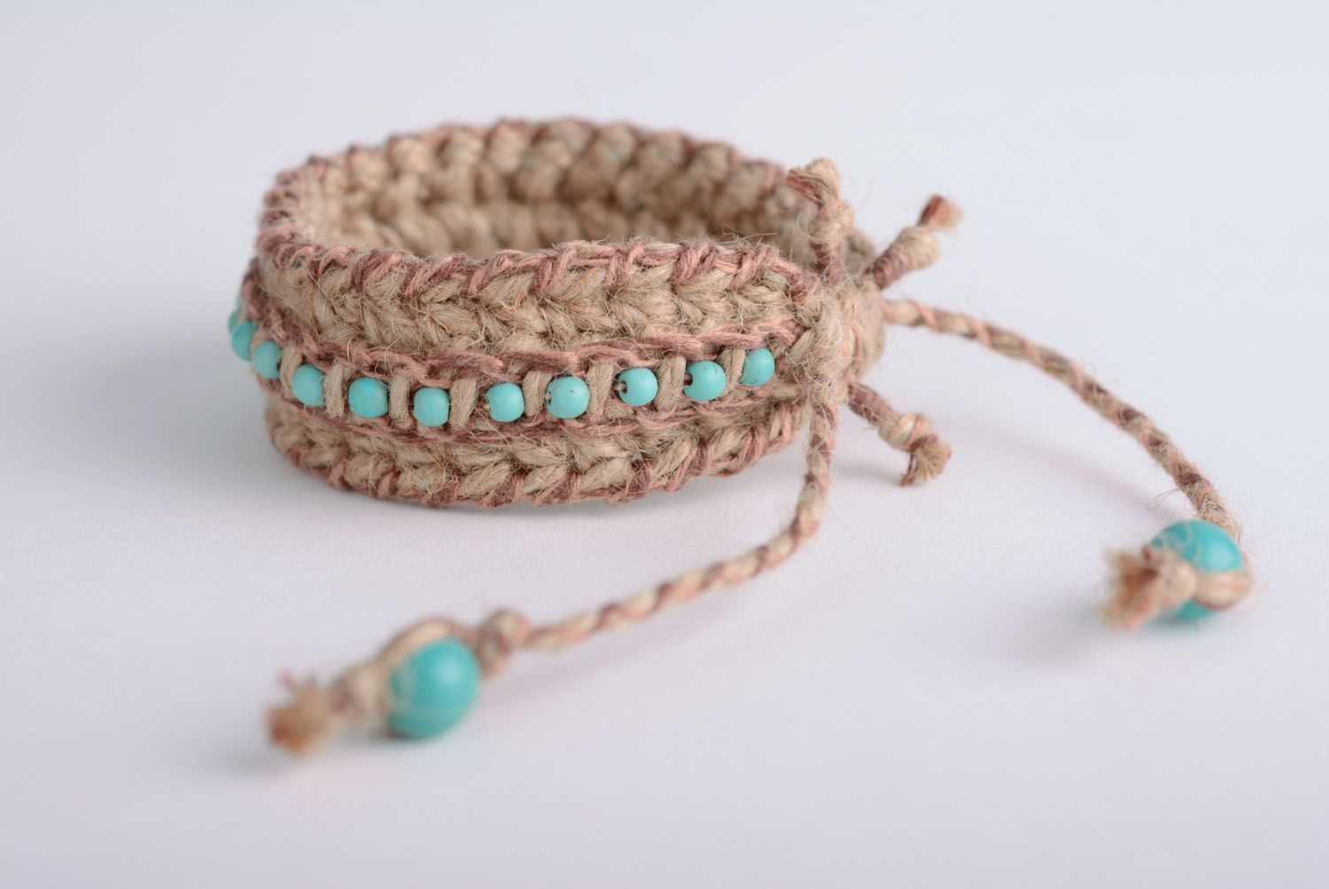 Friendship barcelet woven of jute and linen threads photo 3