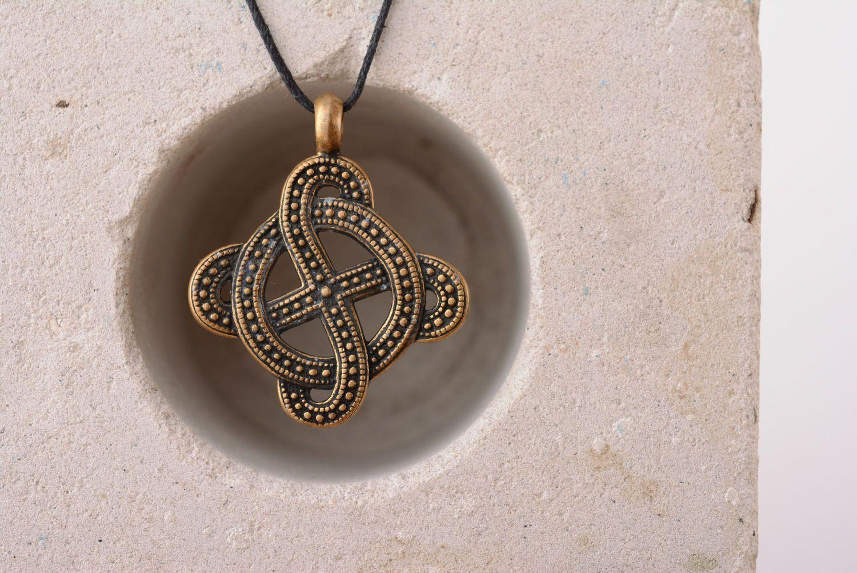 Bronze pendant with solar symbol photo 3