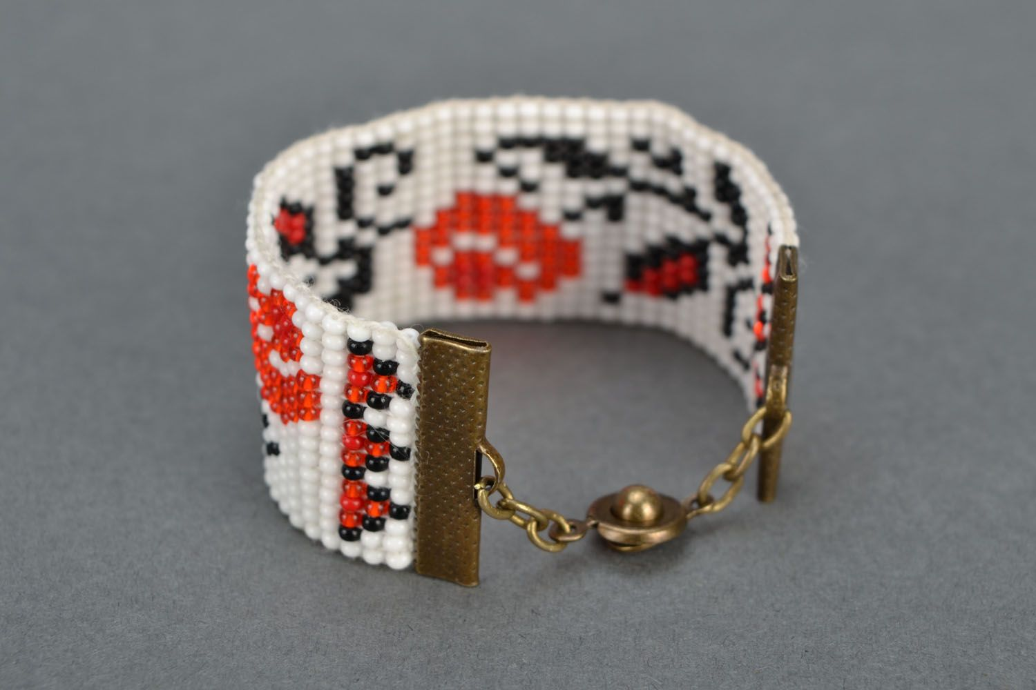 Wide beaded bracelet with ethnic pattern photo 5