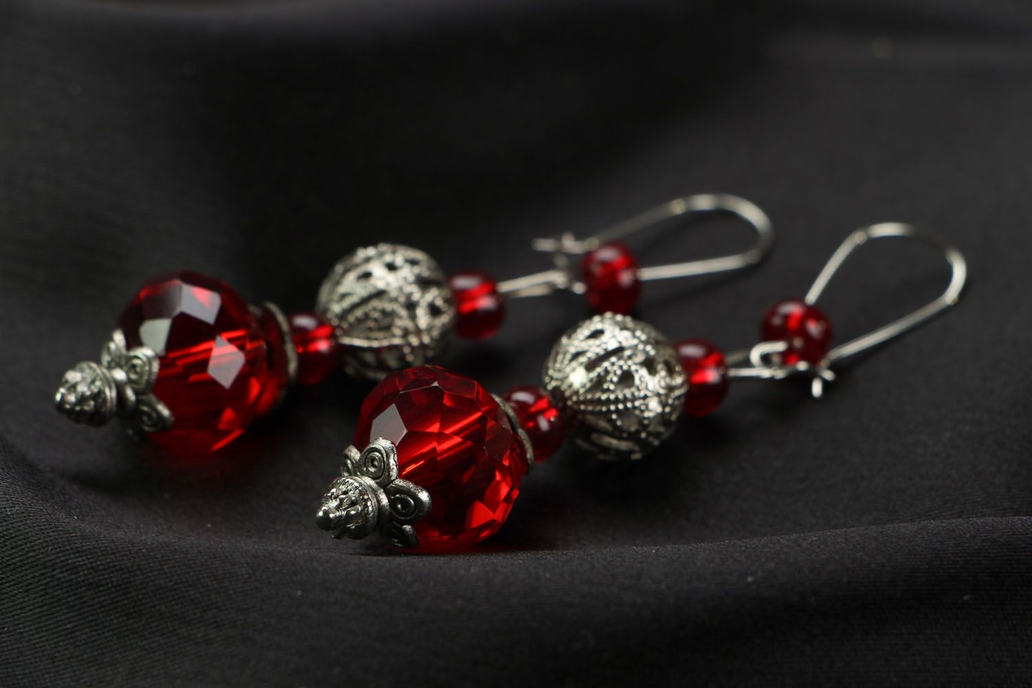 Earrings made of red plastic beads photo 2