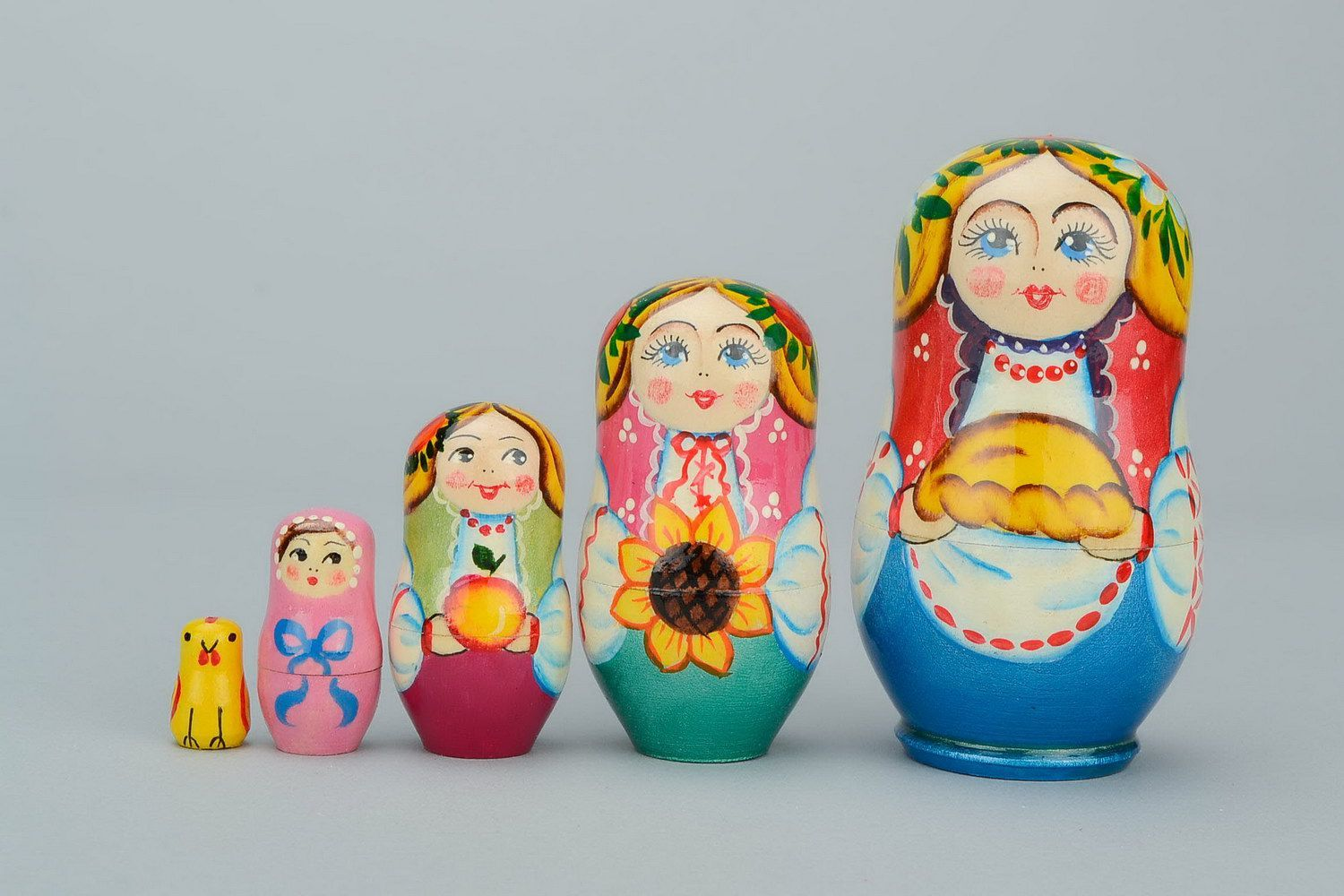 Wooden matryoshka doll with loaf photo 3