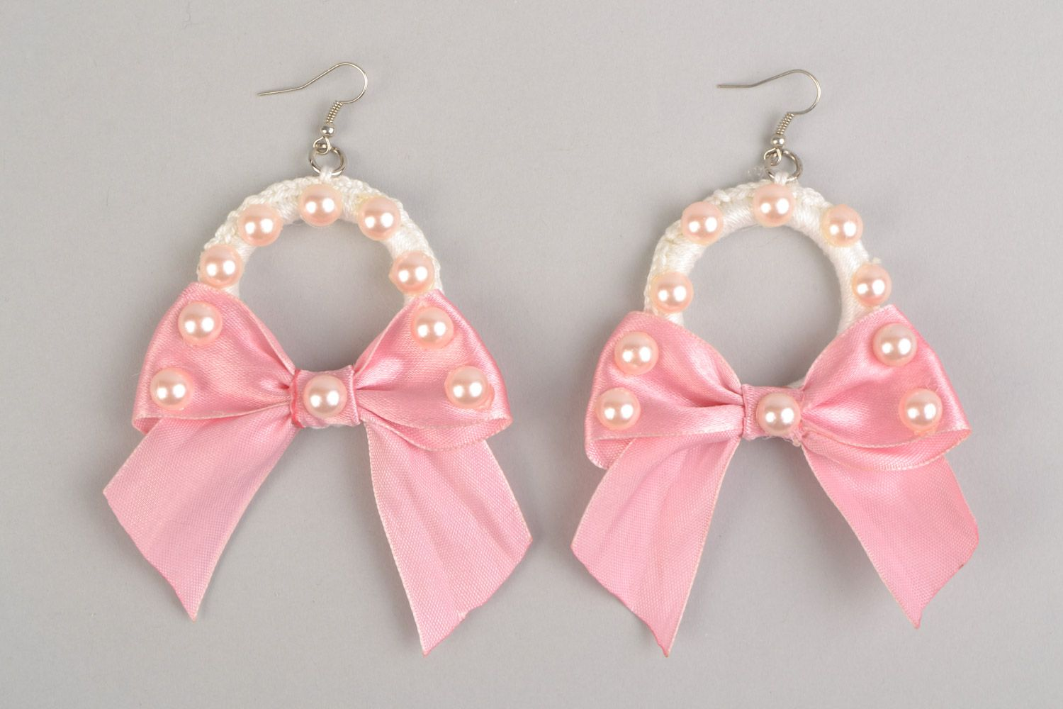 Braided earrings made of plastic rings and threads with pink ribbons present for girlfriend photo 2