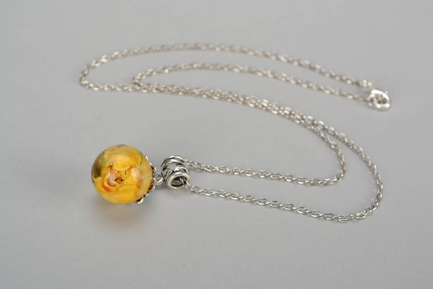 Pendant with rose on a long chain photo 3