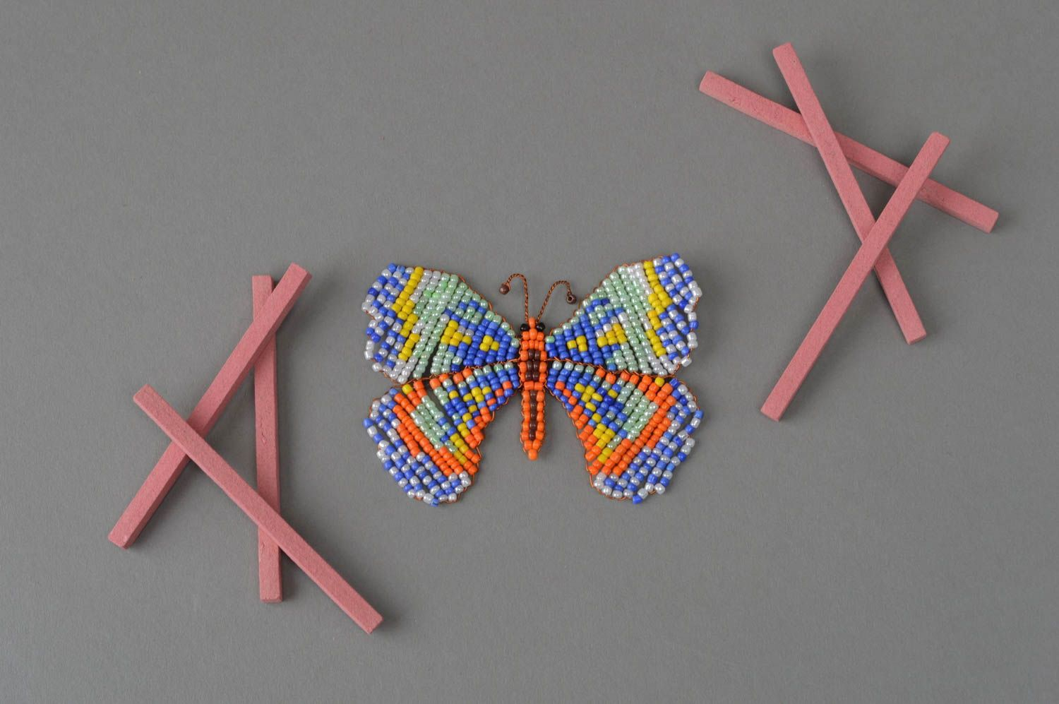 Unusual handmade woven magnet-butterfly on the fridge made of beads photo 1