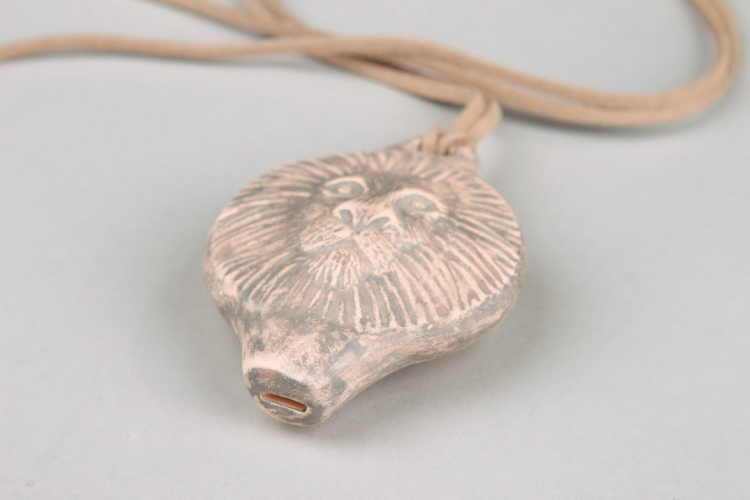 Ceramic tin whistle pendant in the form of lion's head photo 4