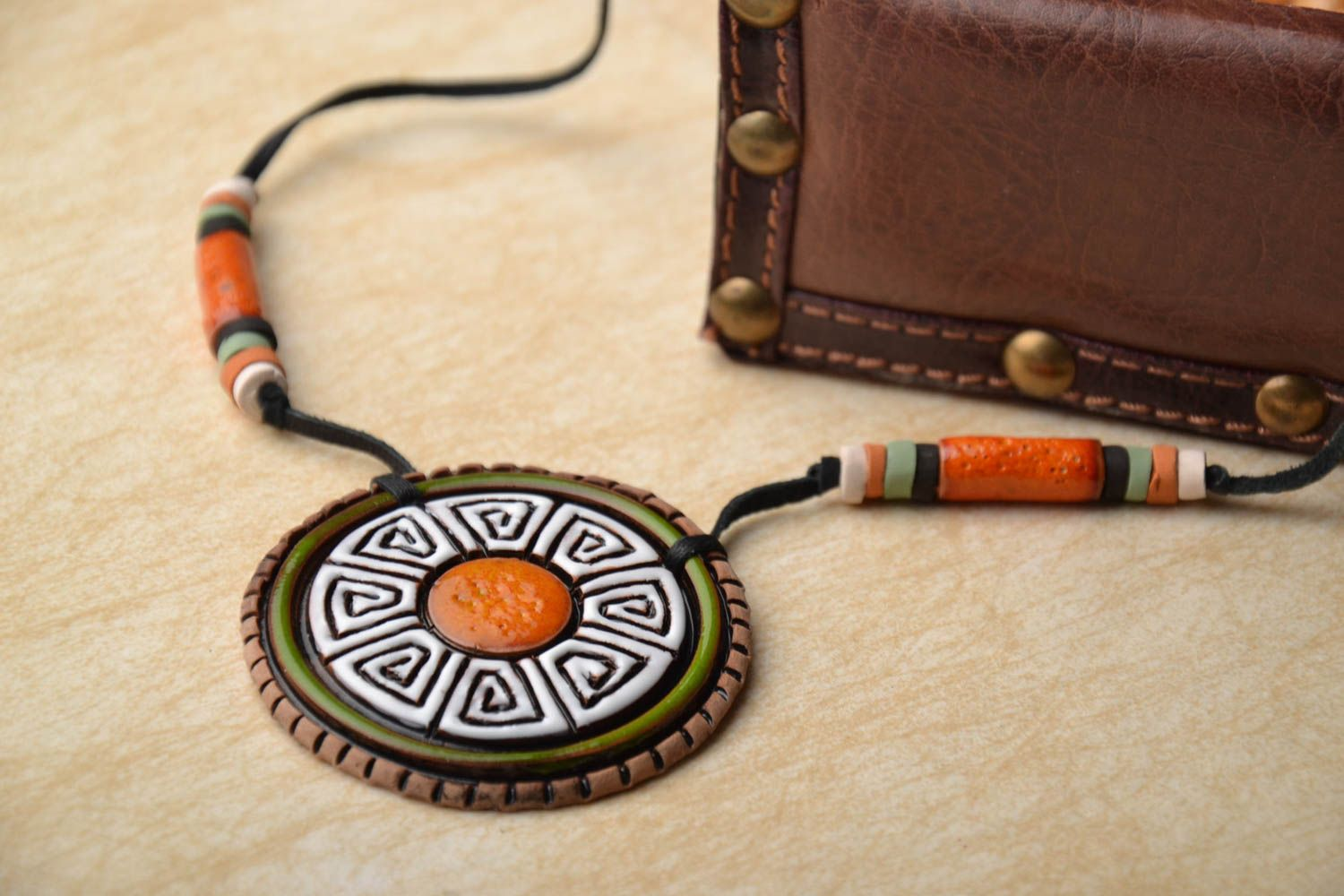 Ceramic pendant in ethnic style photo 1