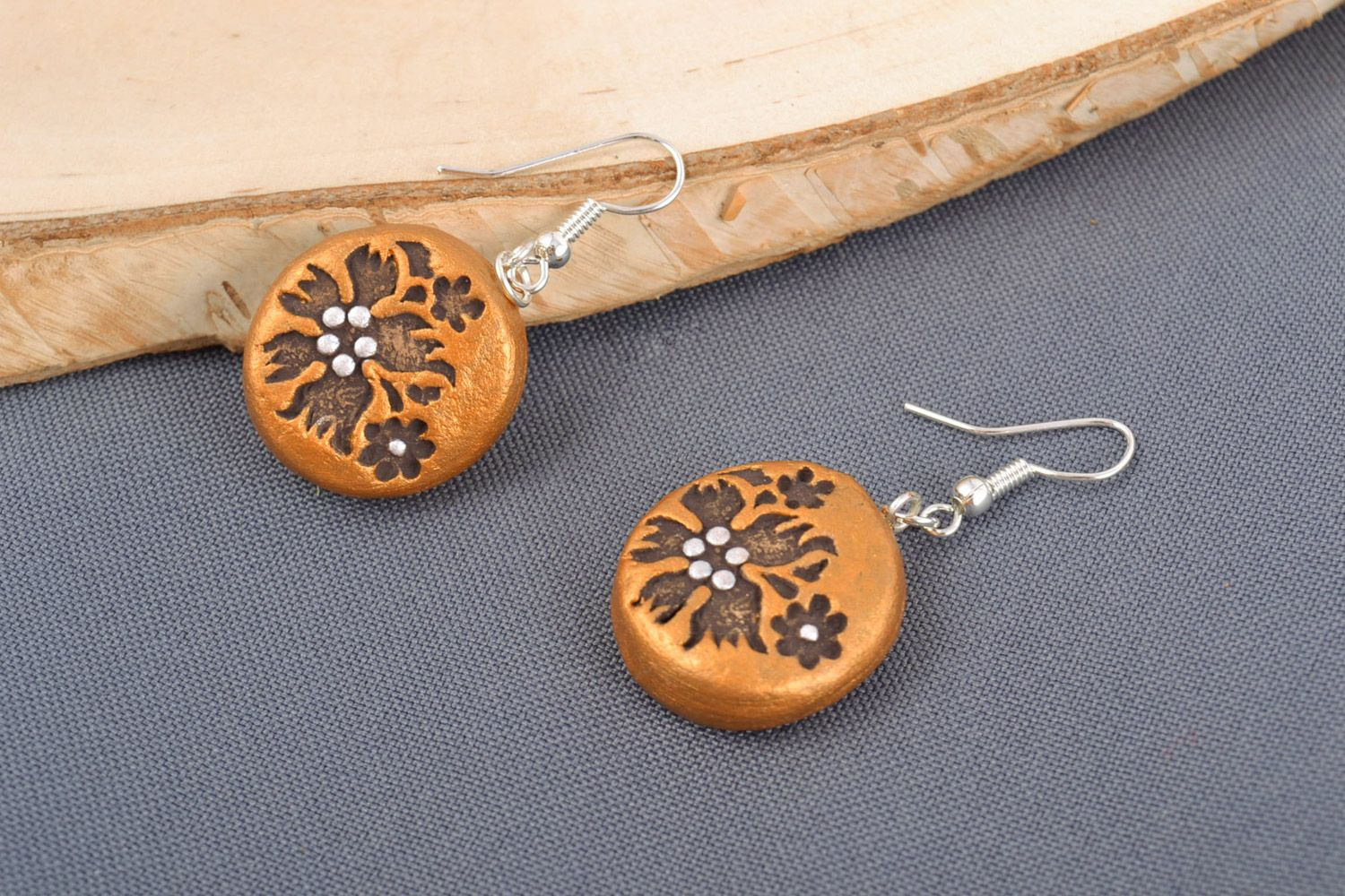 Handmade dangle clay round earrings of gold color with patterns photo 1