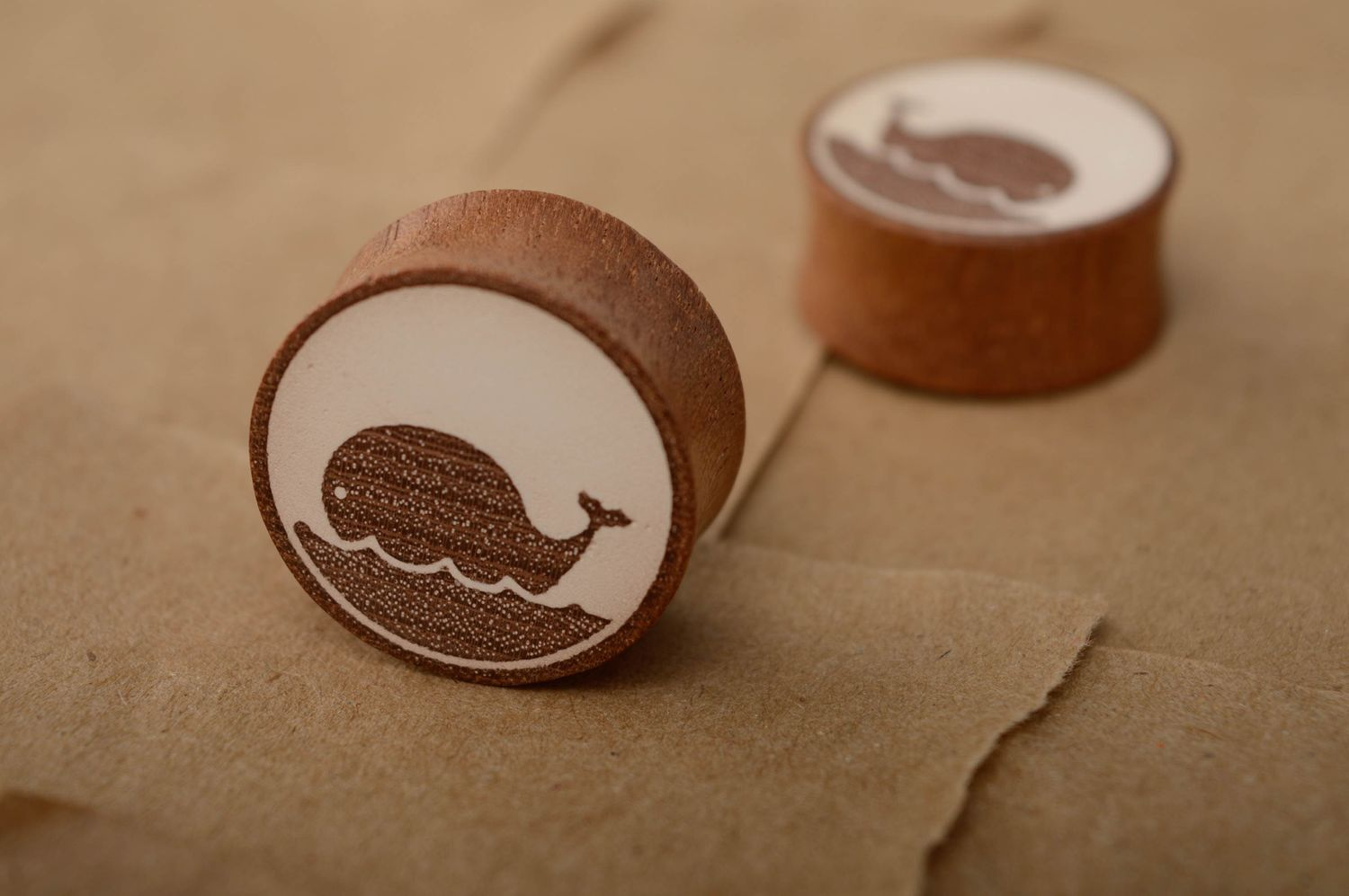 Ear stretching plugs Sapele wood ear plugs with image of whales - MADEheart.com