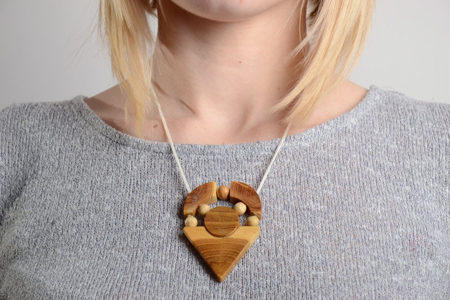 Handmade geometric neck pendant carved of wood and varnished on cord for ladies photo 2