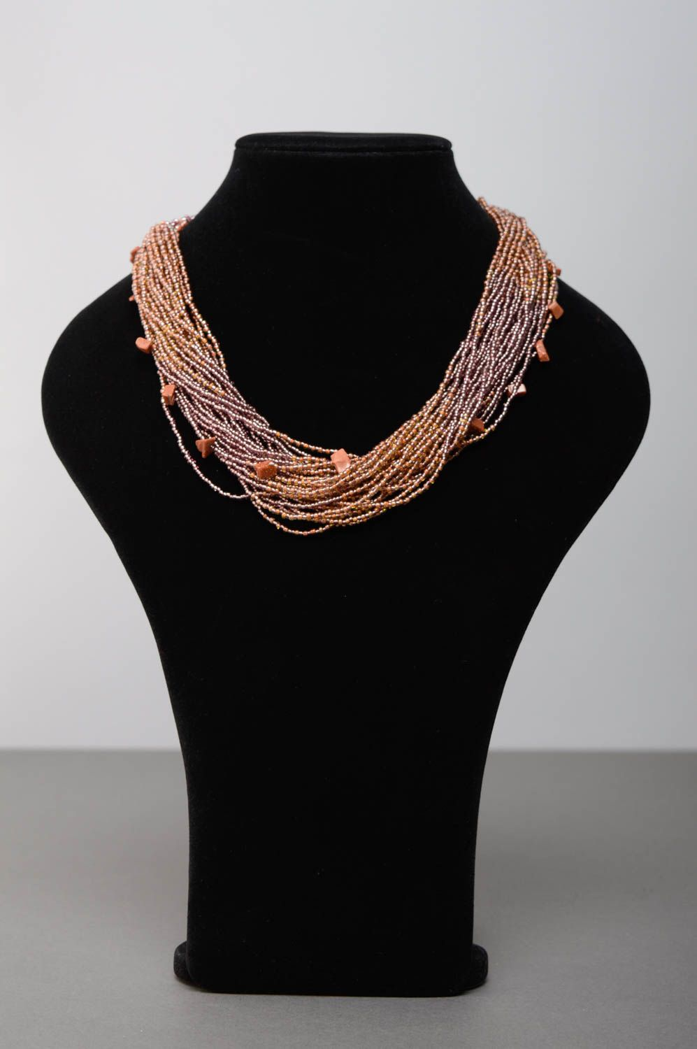 Multi-row beaded necklace of beige color photo 2