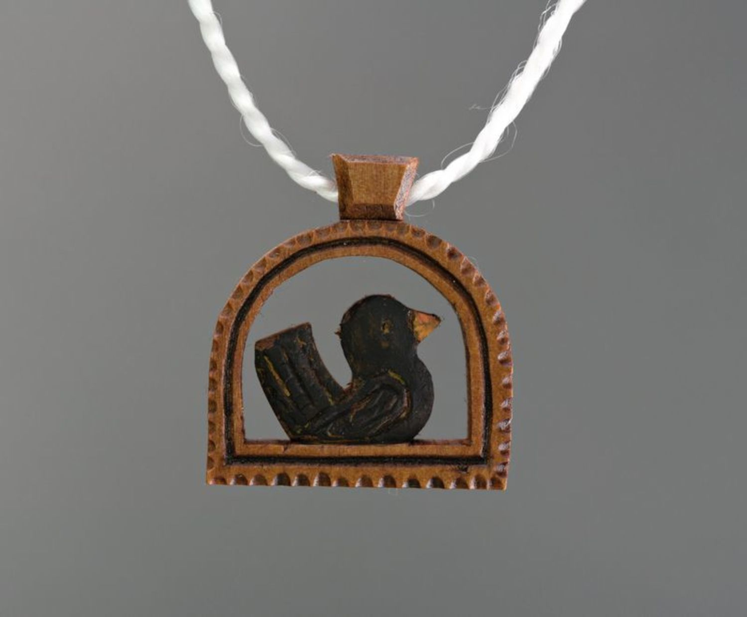 Wooden pendant in the shape of a bird photo 5