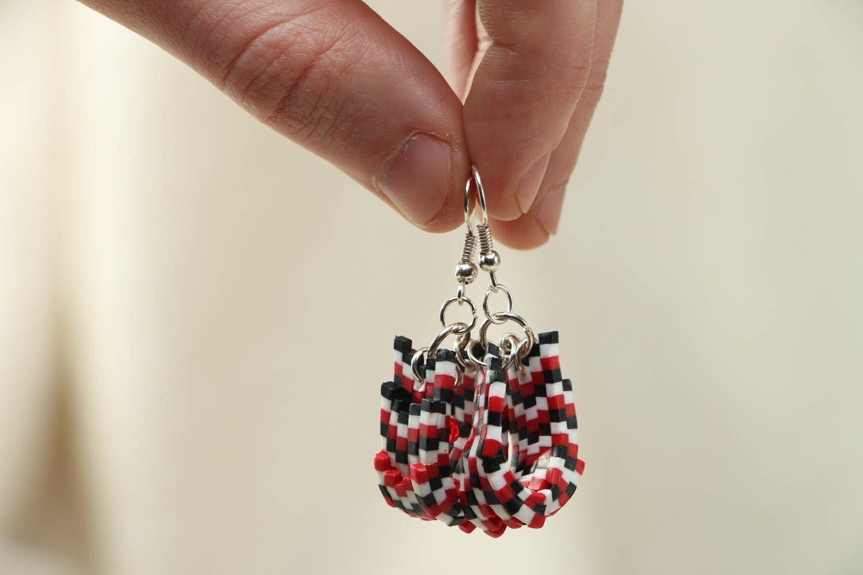 Stylish plastic earrings photo 3