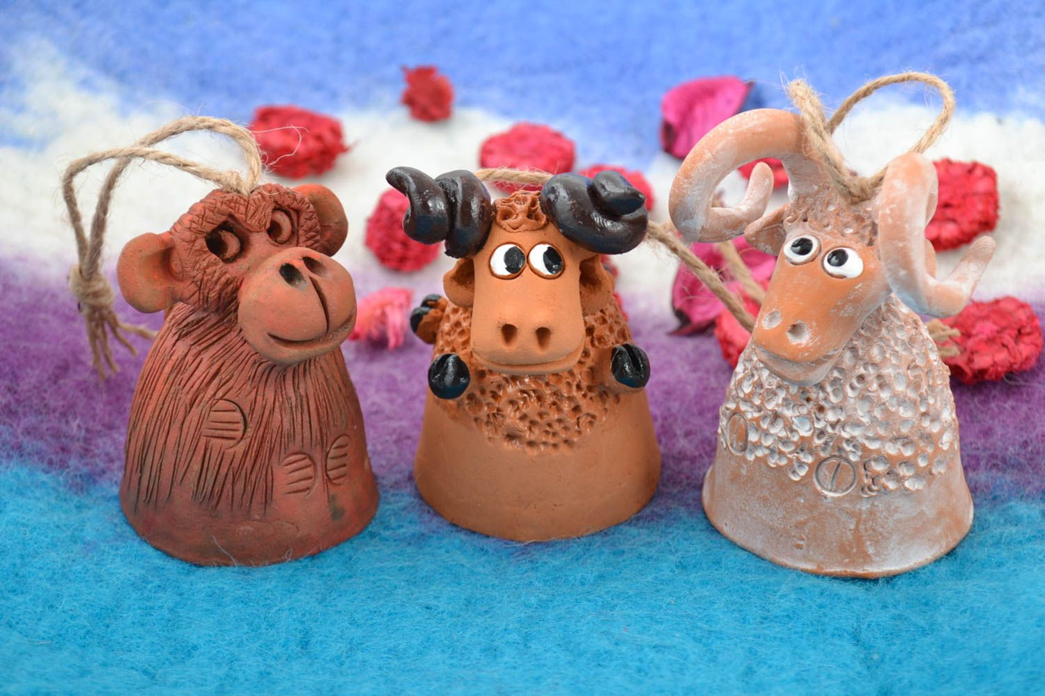 Set of funny handmade ceramic painted figured bells in the shape of animals photo 1