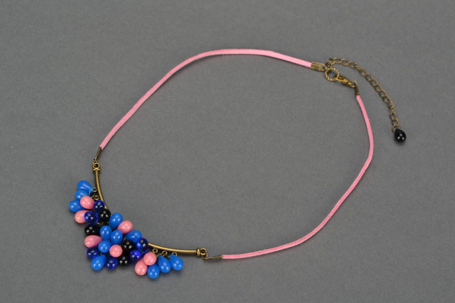 Handmade women's necklace with bright glass beads on suede pink cord photo 1
