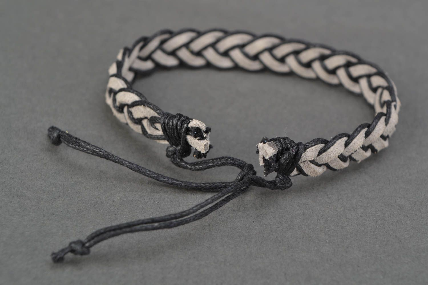 Woven suede bracelet with ties photo 4