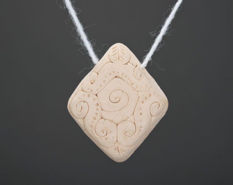 Clay pendant photo 1