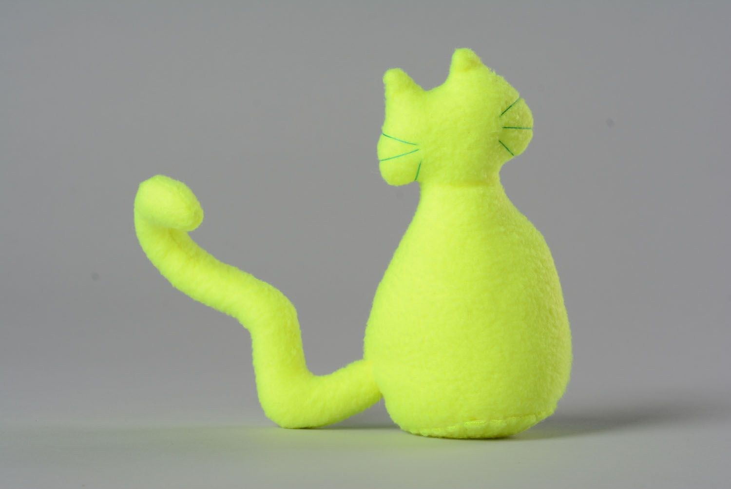Soft toy in the shape of a yellow and green cat photo 5