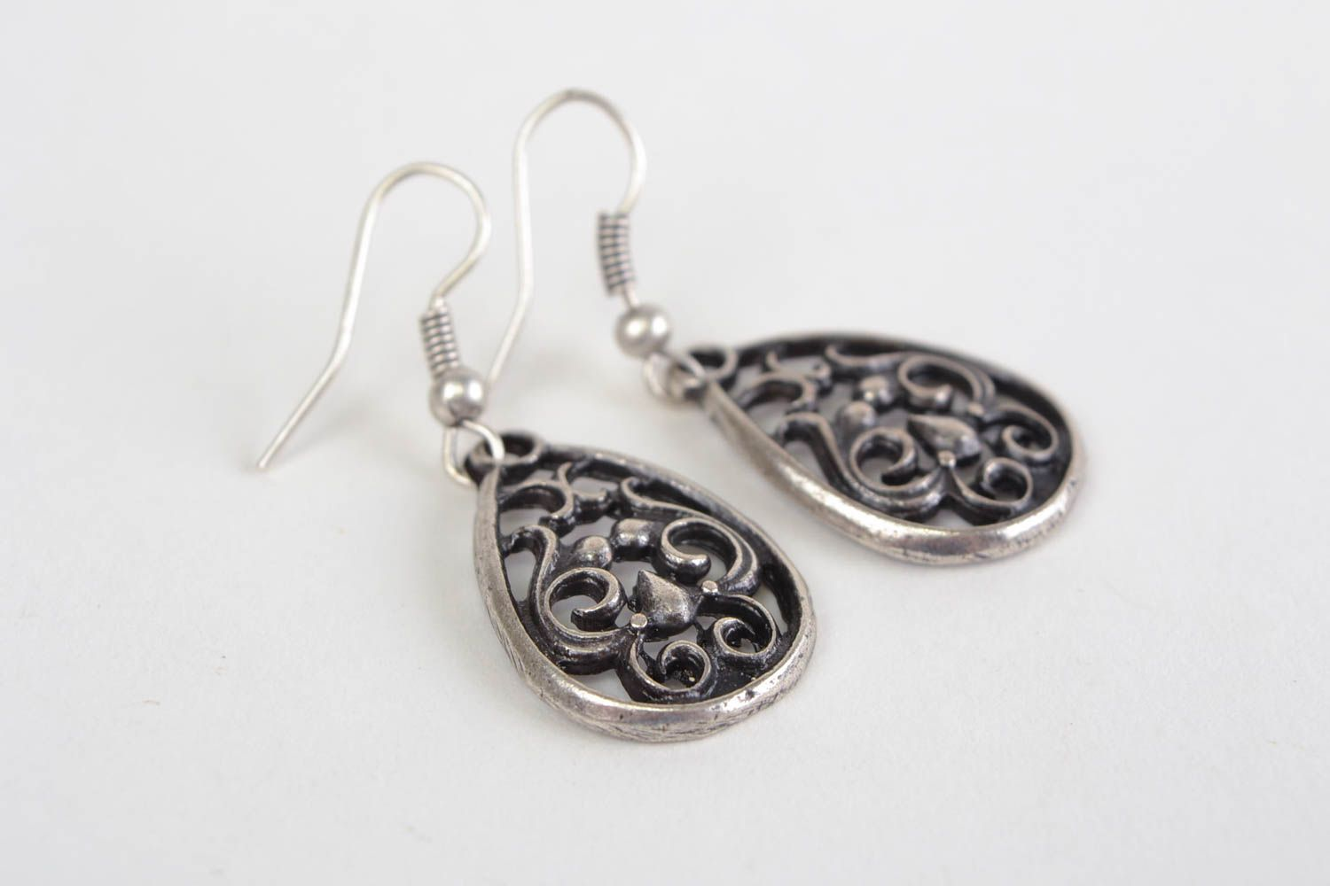 Beautiful handmade design metal lace earrings of silvery color photo 2