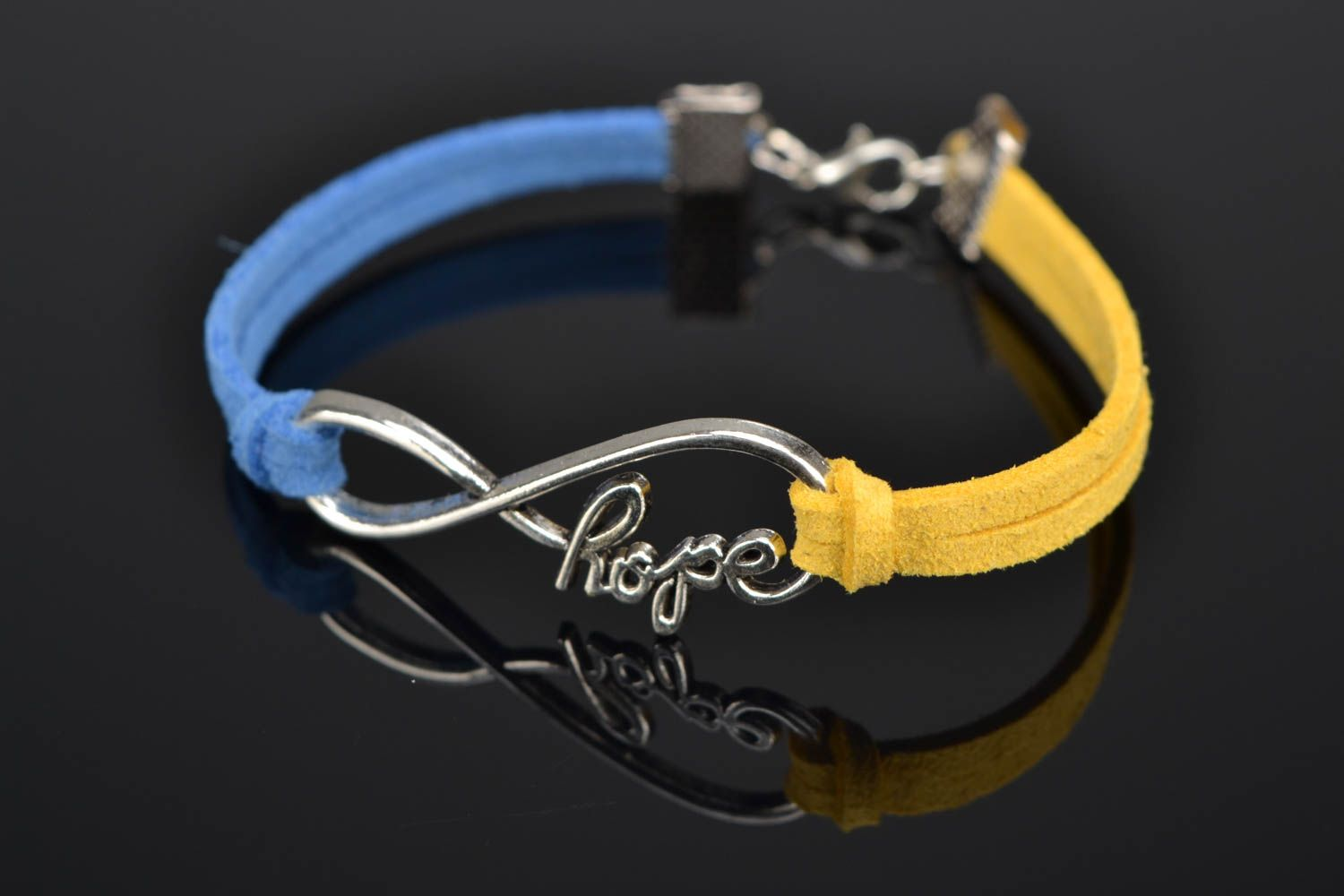 Suede bracelet with metal insert photo 1