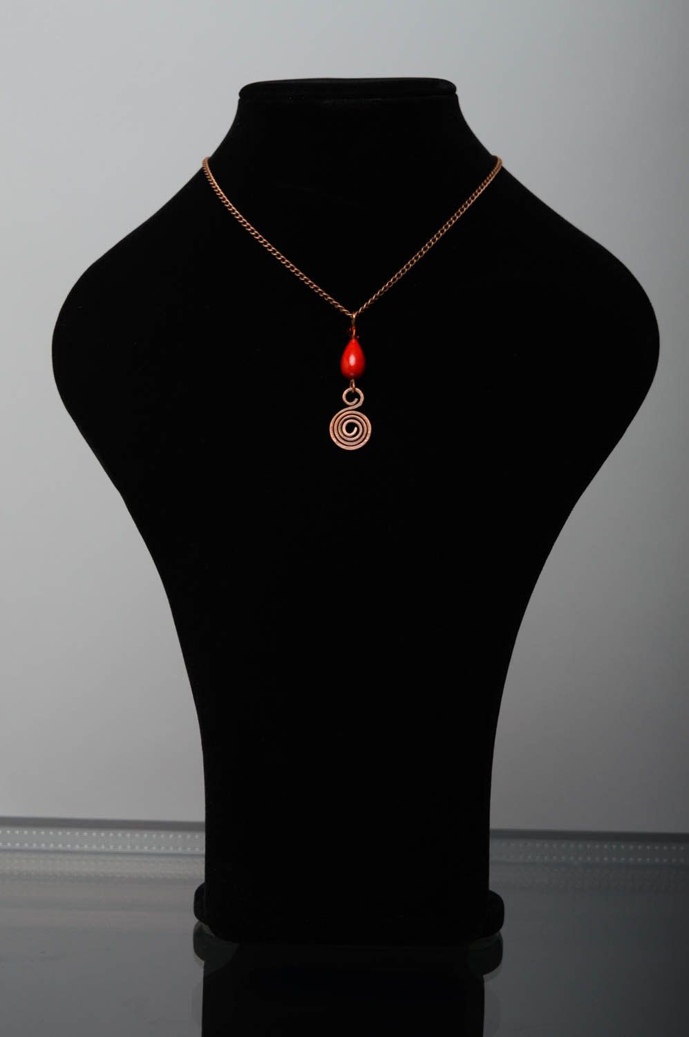 Copper pendant with natural coral photo 2